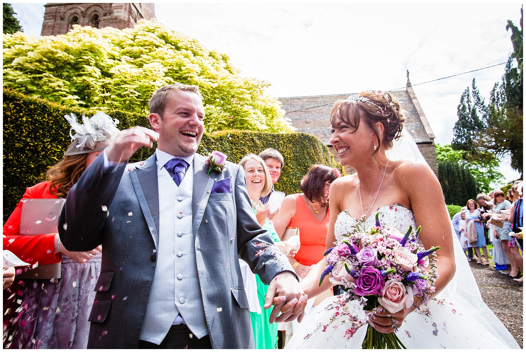 bride and groom laughing after confetti shot - shropshire photographer