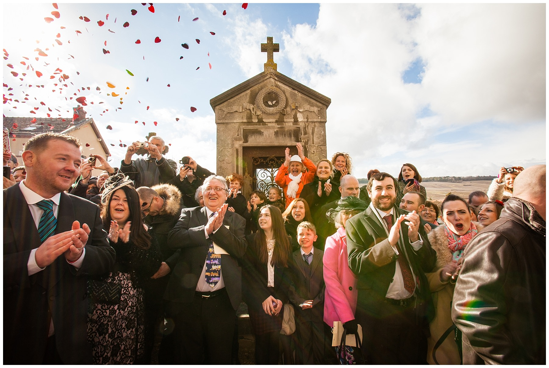 guests at sacey, france wedding watching - confetti shot - destination photographer
