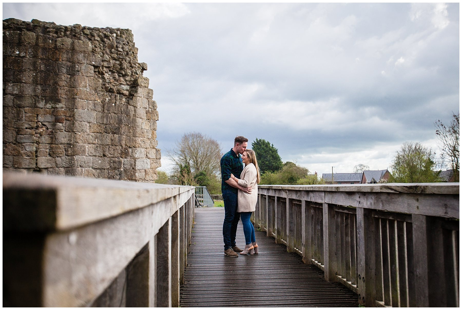 happy couple chatting on the bridge at whttington castle- charlotte giddings photography