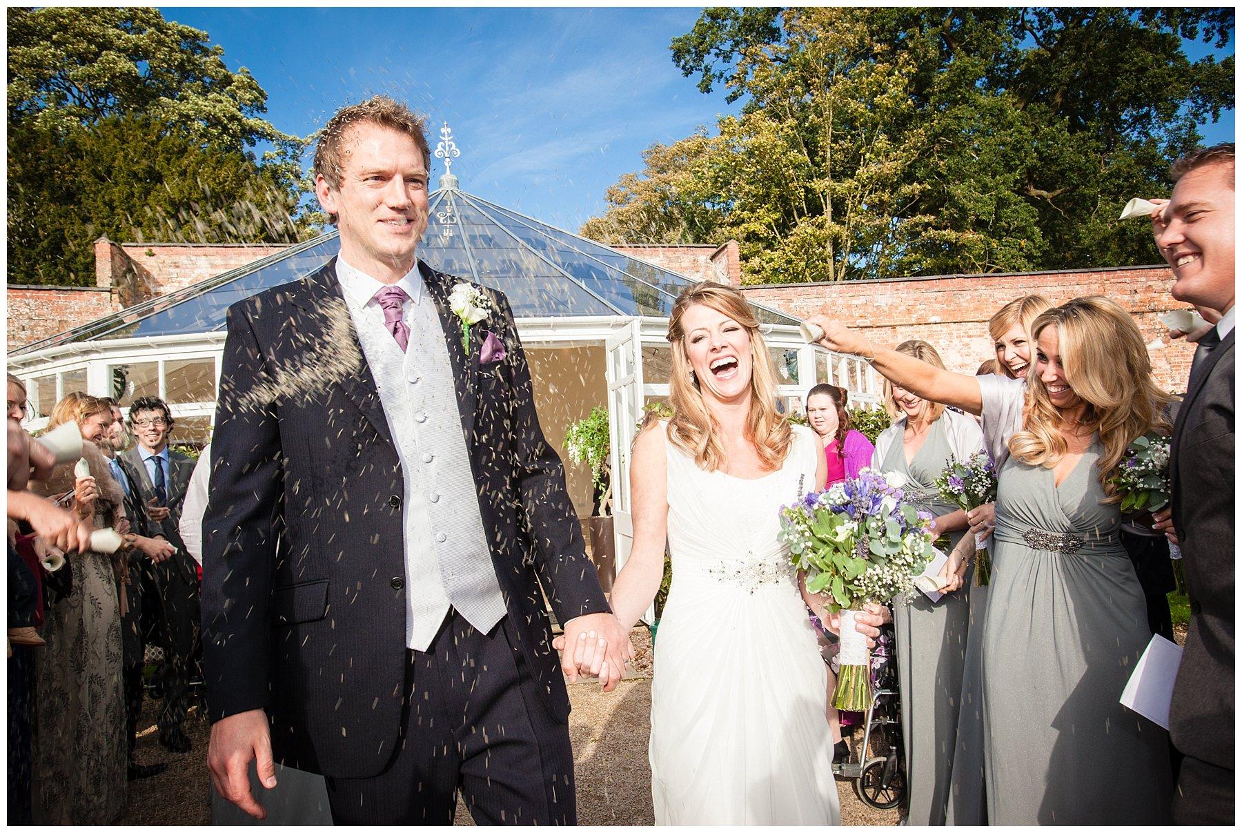 autumn combermere abbey with glasshouse confetti shot - wedding photographer shropshire