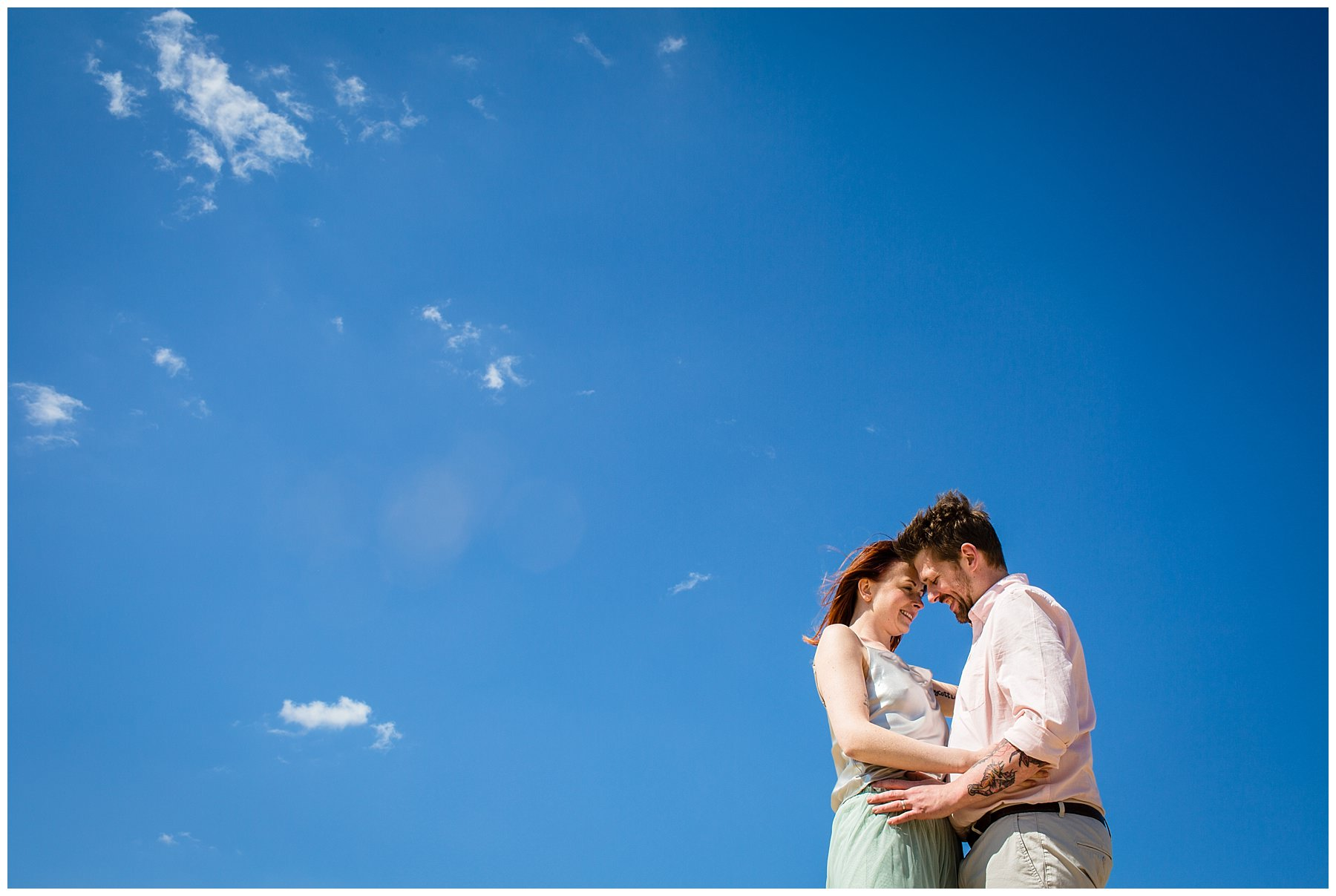 couples forehead close within blue sky - wedding photographer shropshire