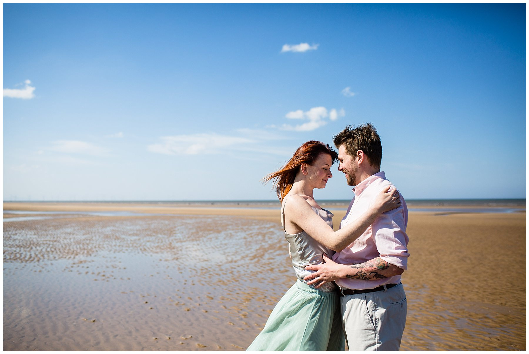couple having a moment on formby beach - shropshire photographer
