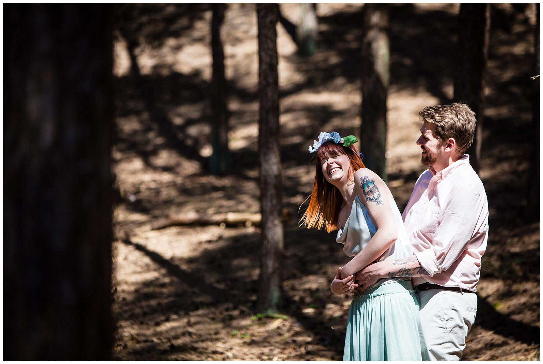couple in natural light laughing in woodland shoot formby - wedding photographer shropshire