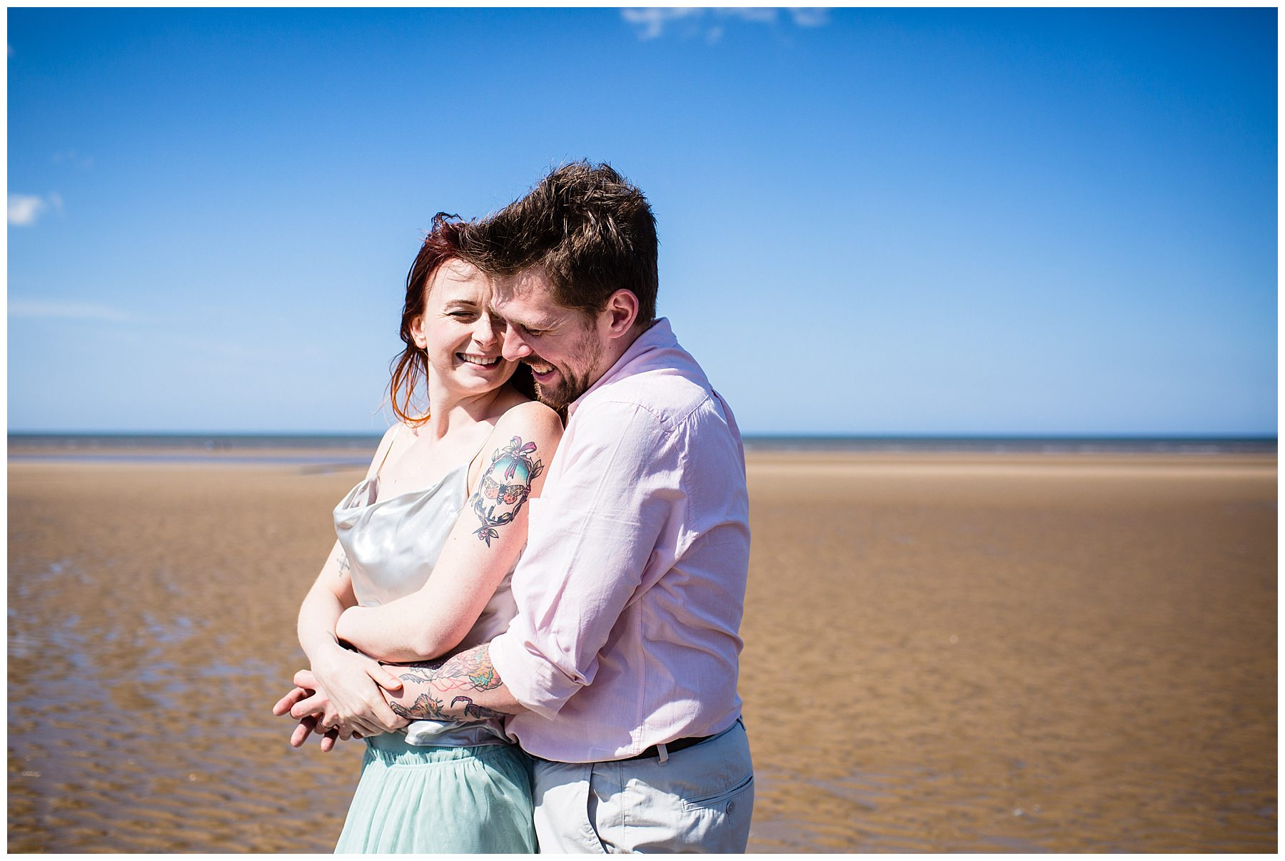 couple close together - formby engagement shoot