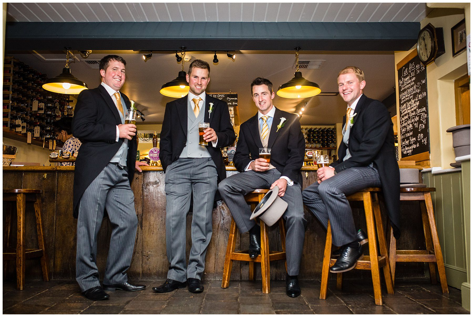 groom and the boys having a drink before ceremony at combermere arms burleydam