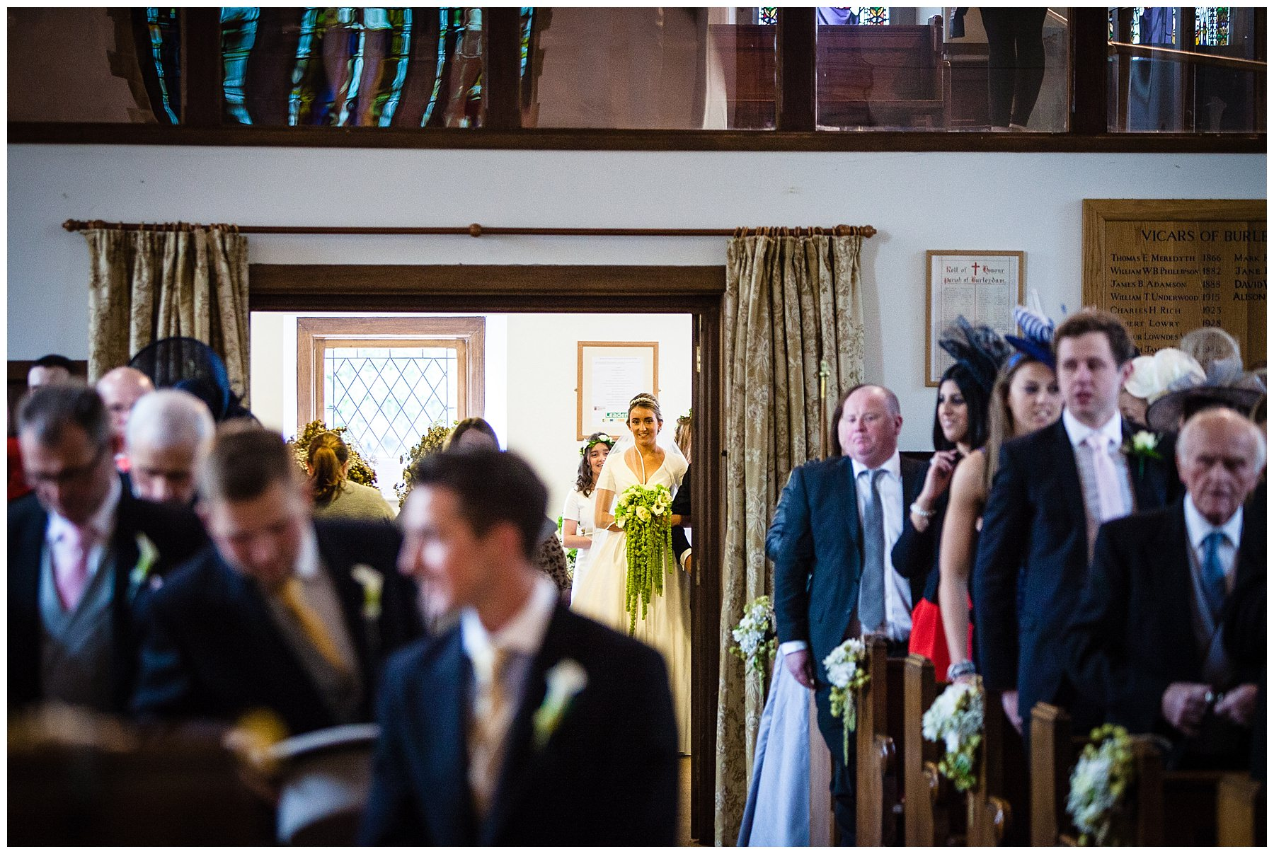 bride looking up the aisle in burleydam church - shropshie wedding photographer