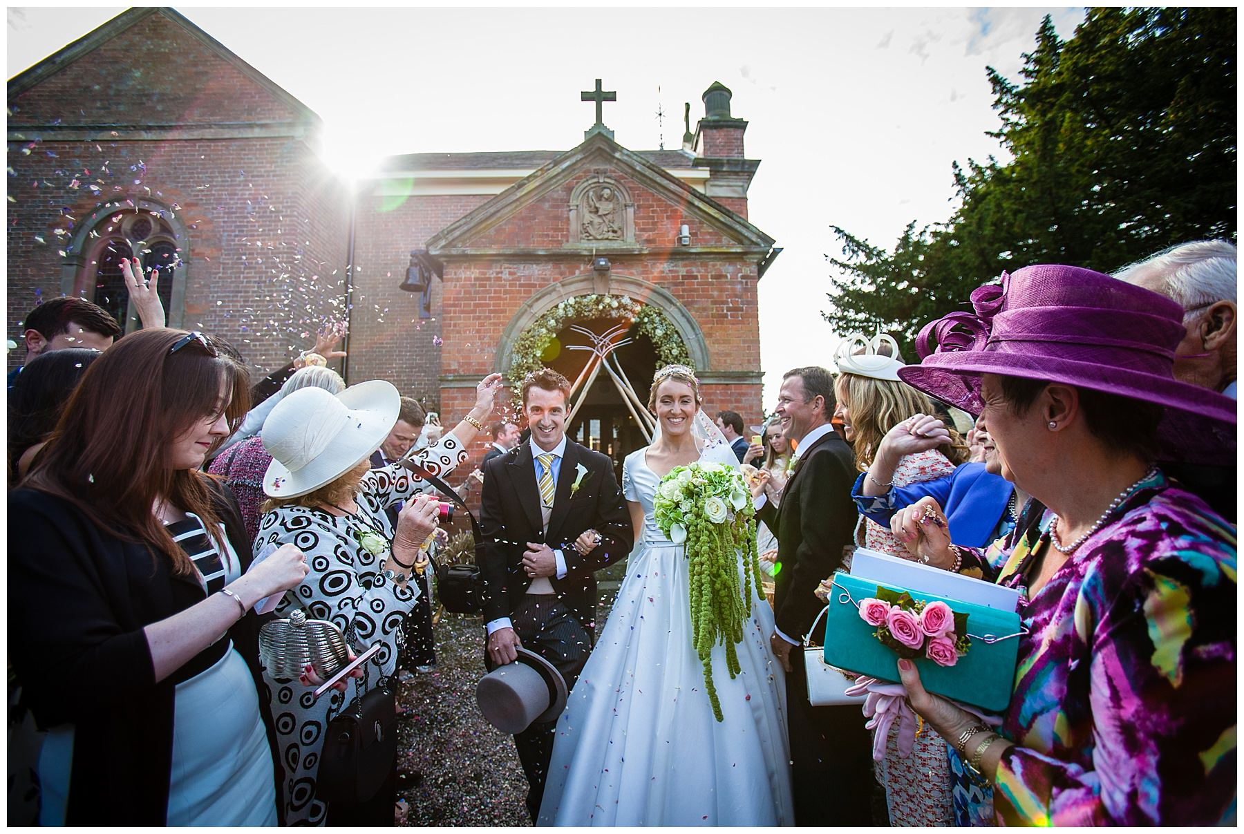 confetti outside burleydam church, shropshire - charlotte giddings photography - Autumnal Wedding Shropshire