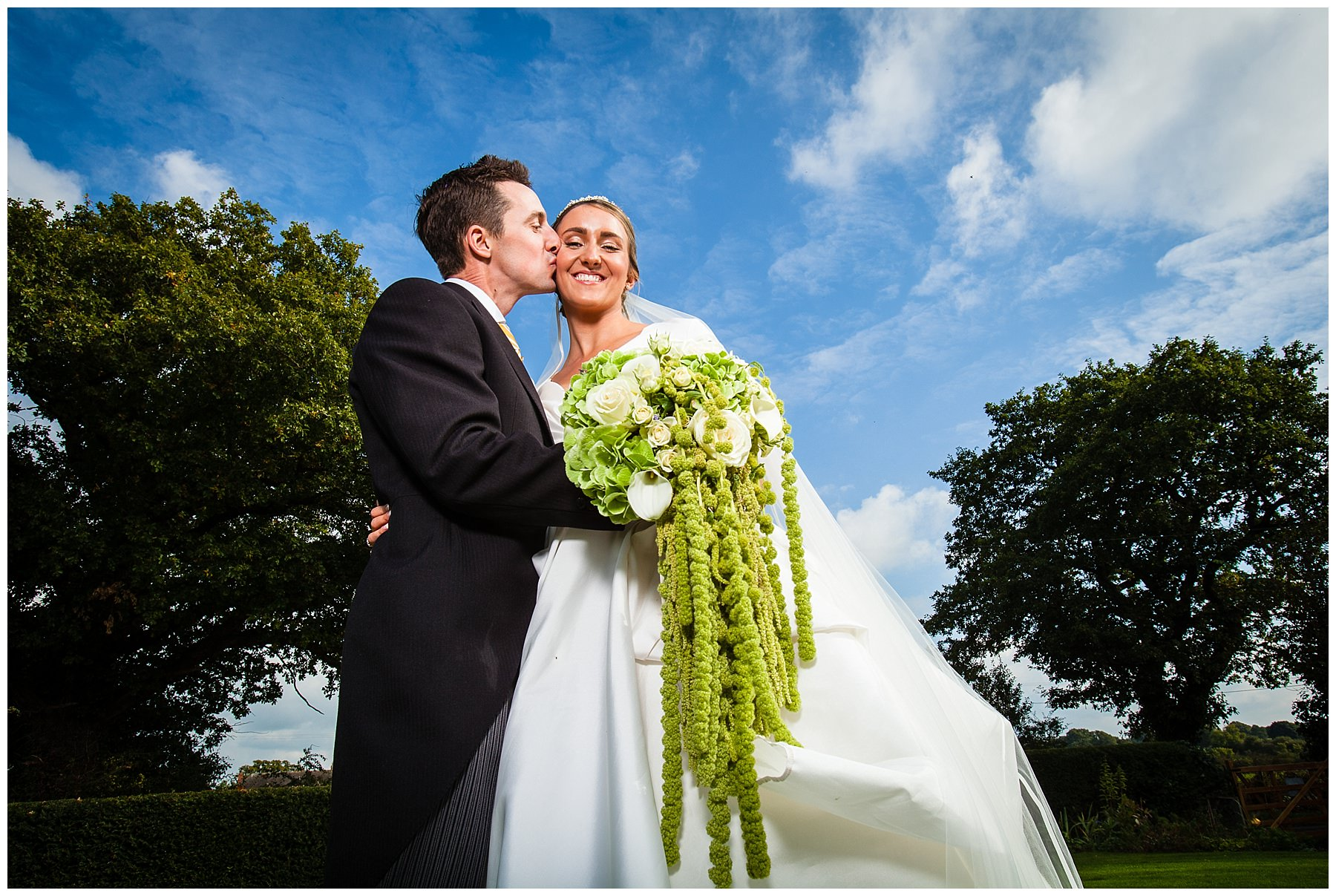 bride and groom in gorgeous blue sky at family home