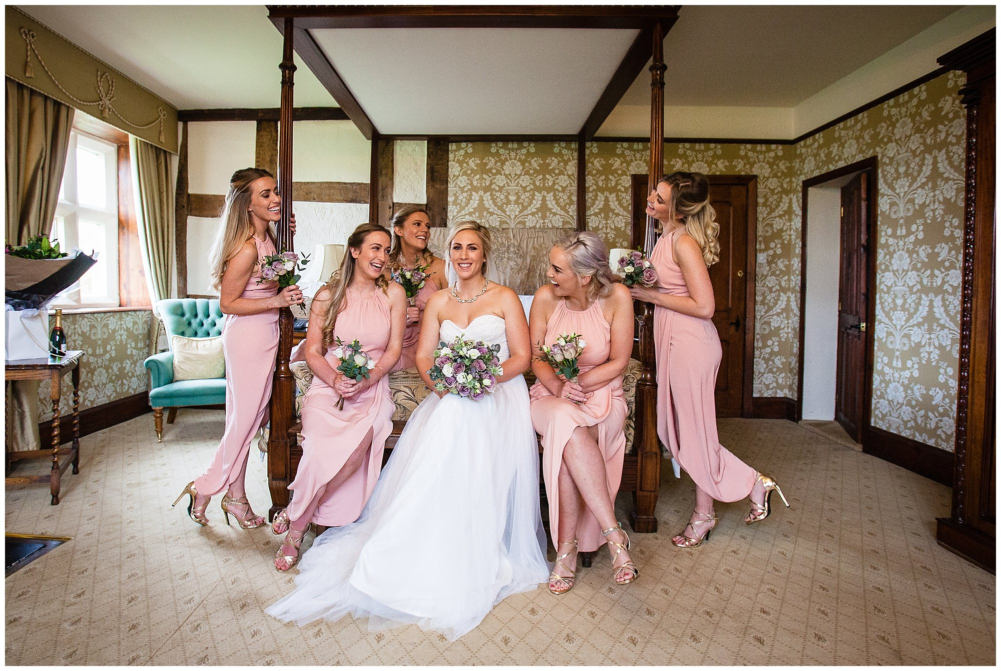 bridesmaids relaxing for portrait of the bridal party