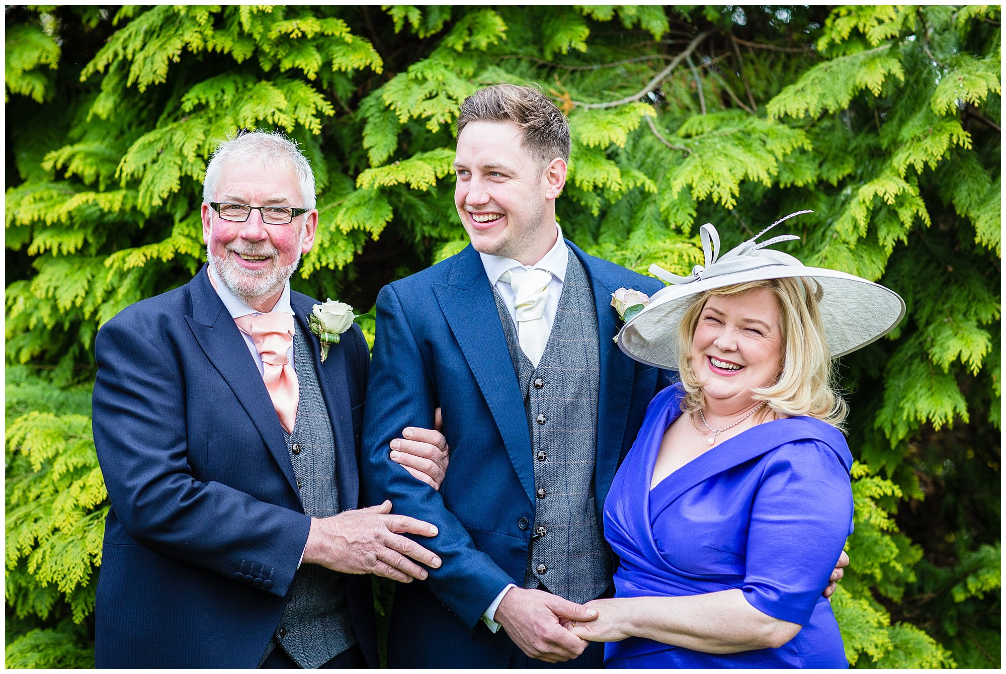 groom informal portrait with mum and dad - shropshire photographer