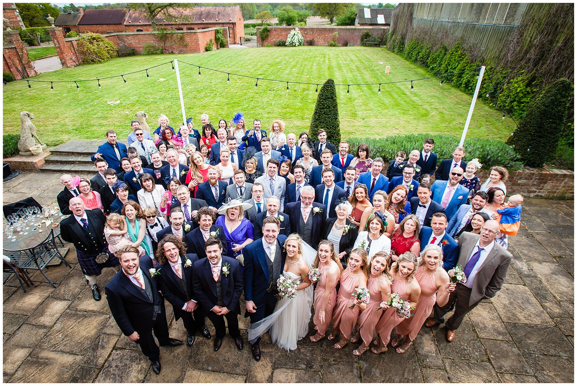 whole group photo outside the moat at soulton hall - shropshire wedding photohrapher