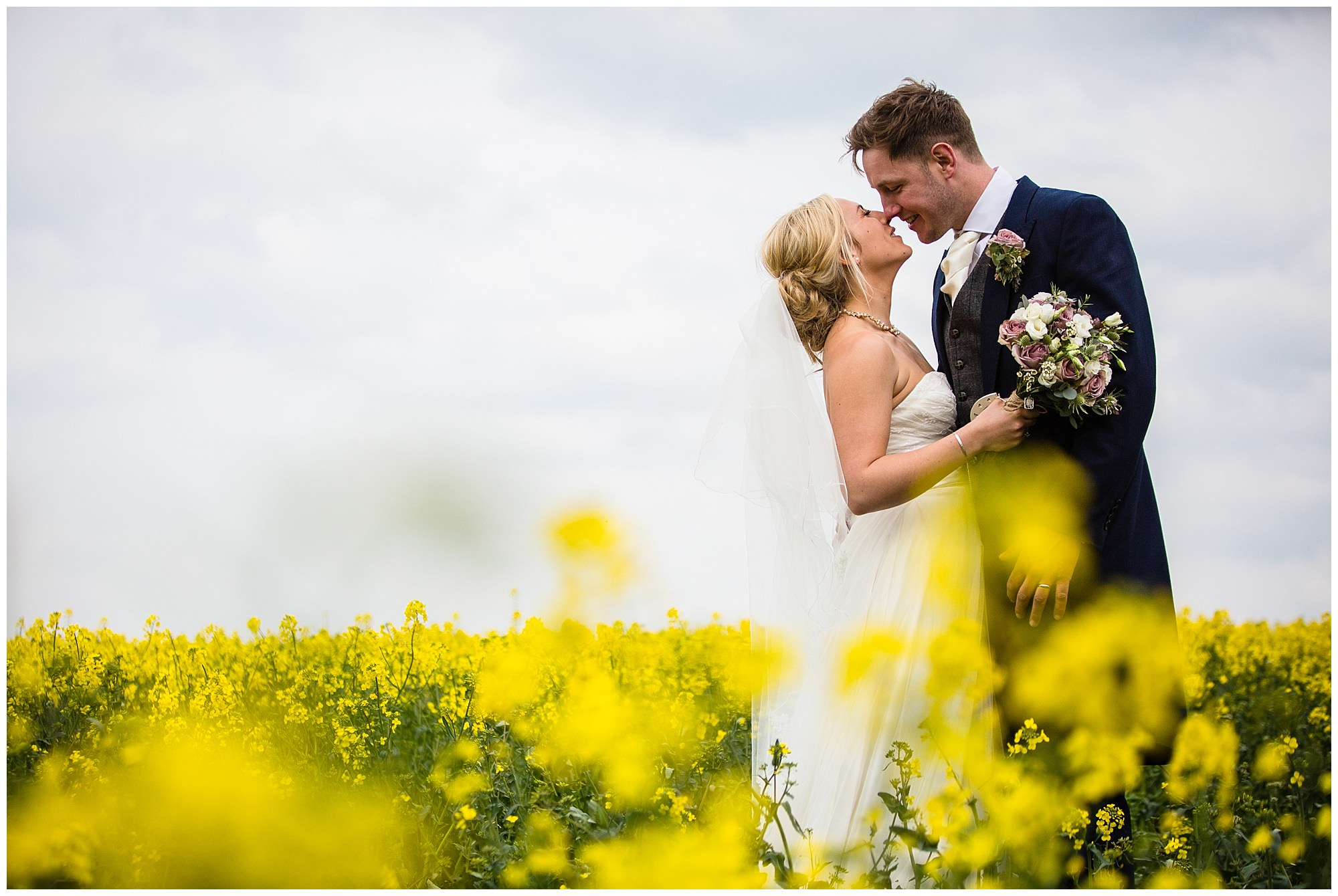 bride and groom having a moment in oil rape seed field - soulton hall sprint wedding