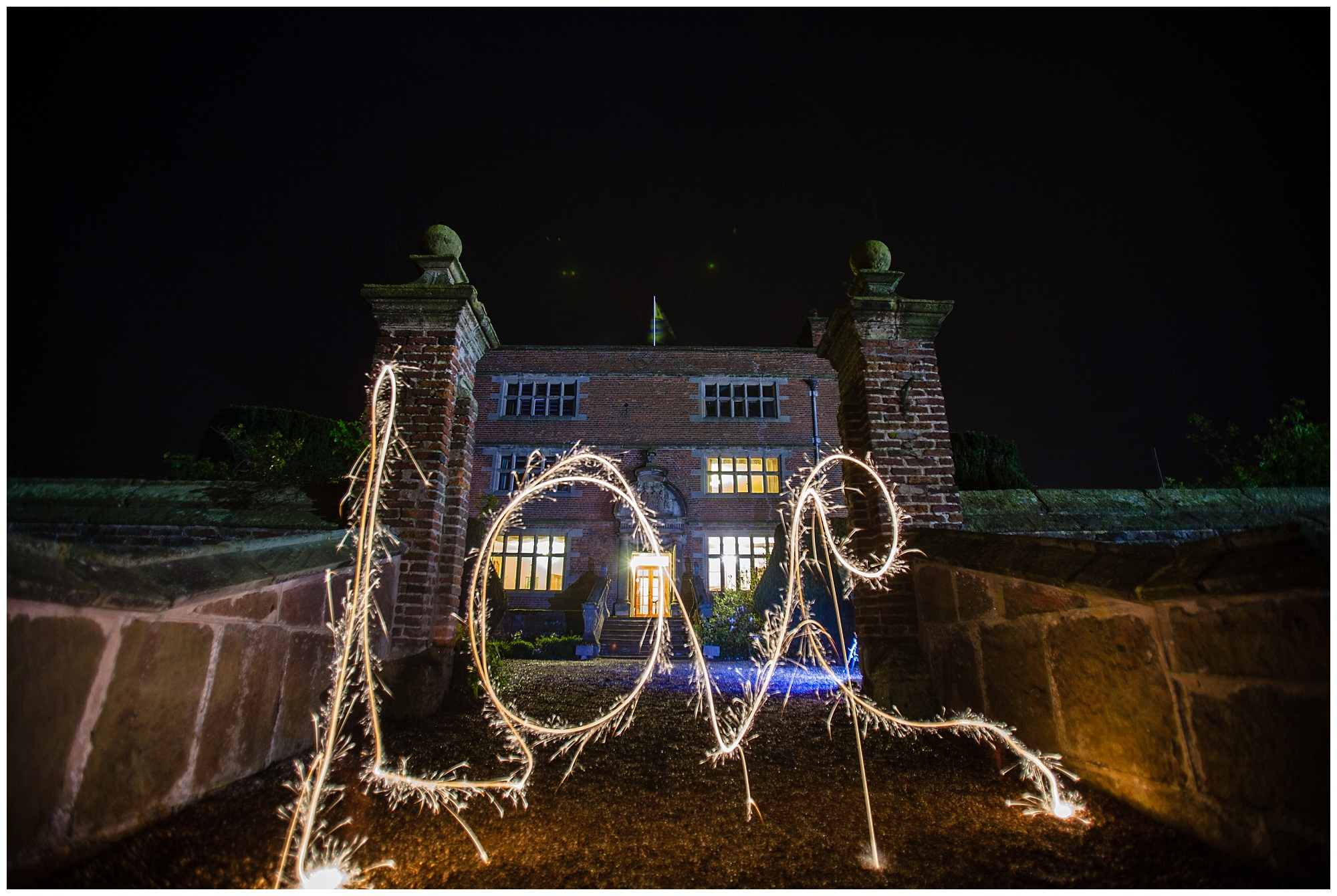love written in front of soulton hall all lit up - charlotte giddings photography