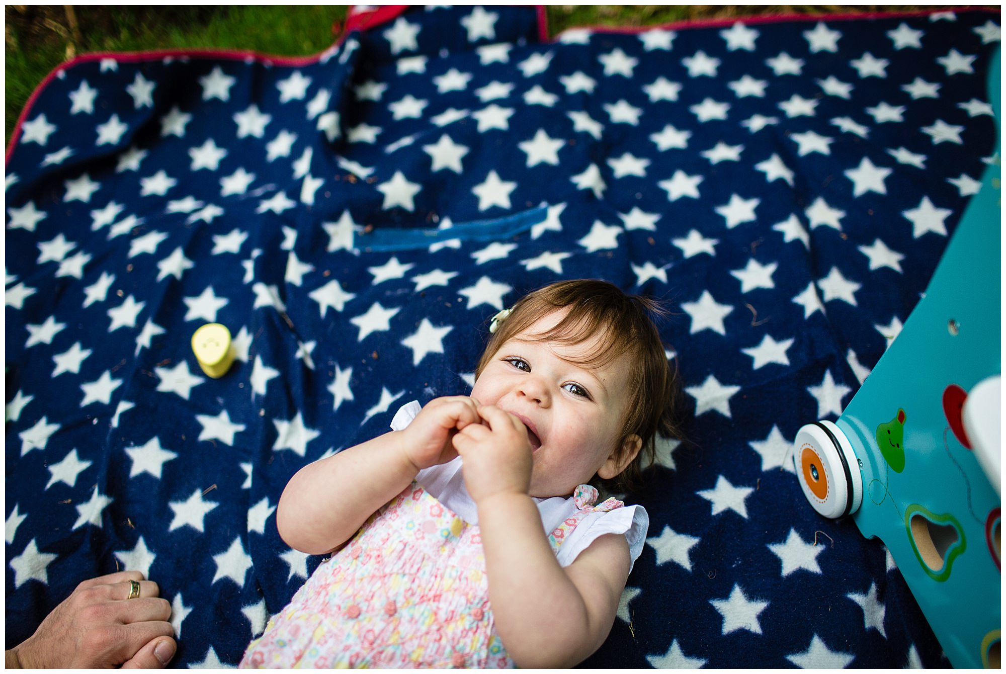 baby girl having a rest lying on a blanket at brown moss whitchurch, shropshire