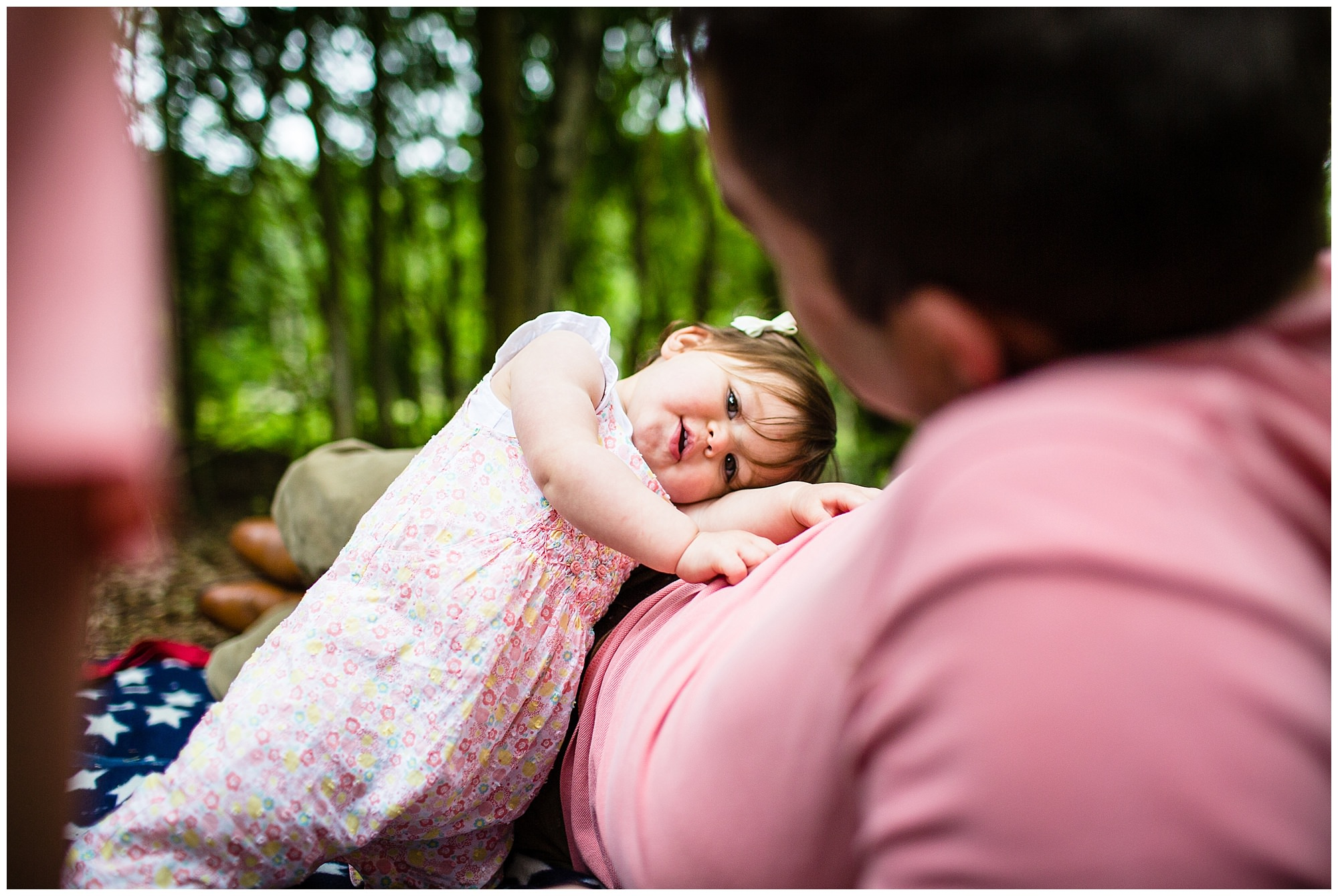 baby girl lying on her daddy having a rest - shropshire photographer
