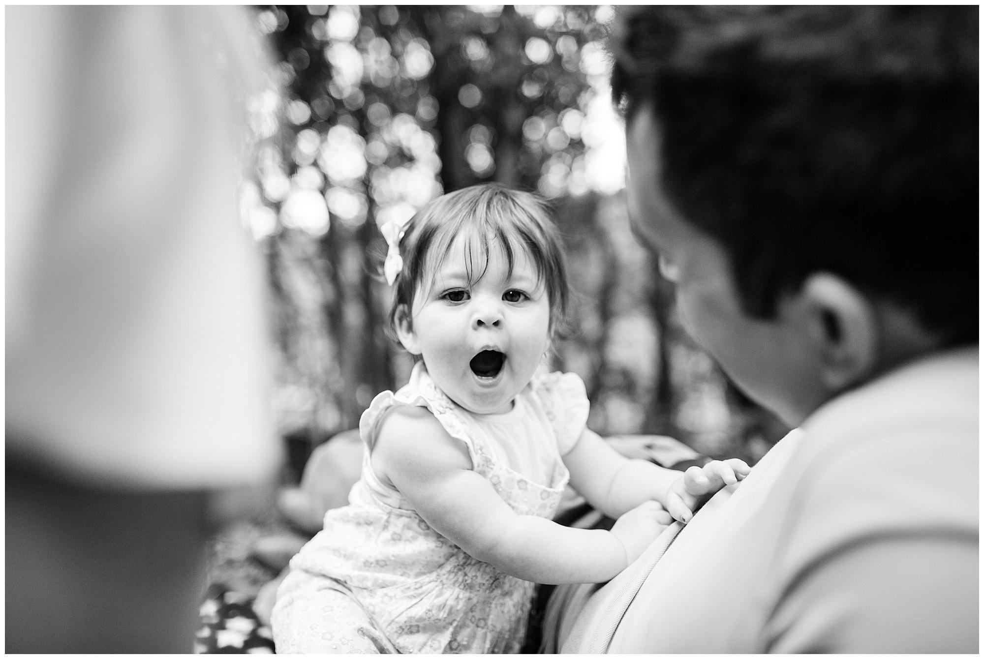 black and white photo of 1 year old girl yawning