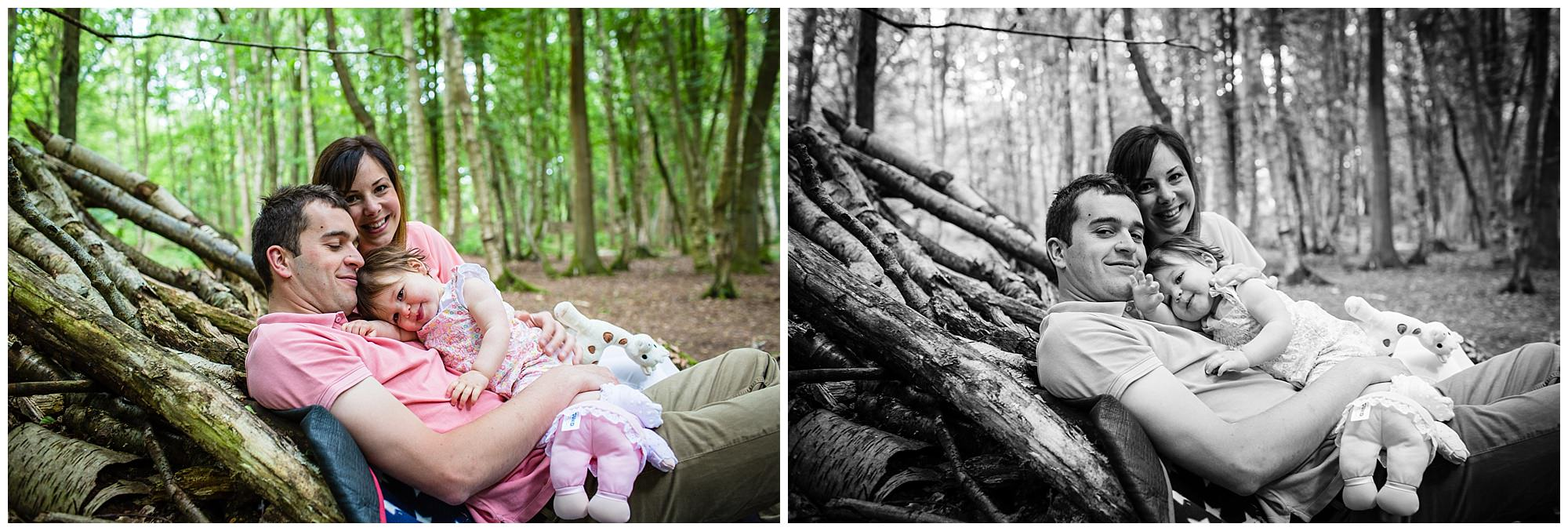 family of three sat against a tree house having a natural moment - charlotte giddings photography