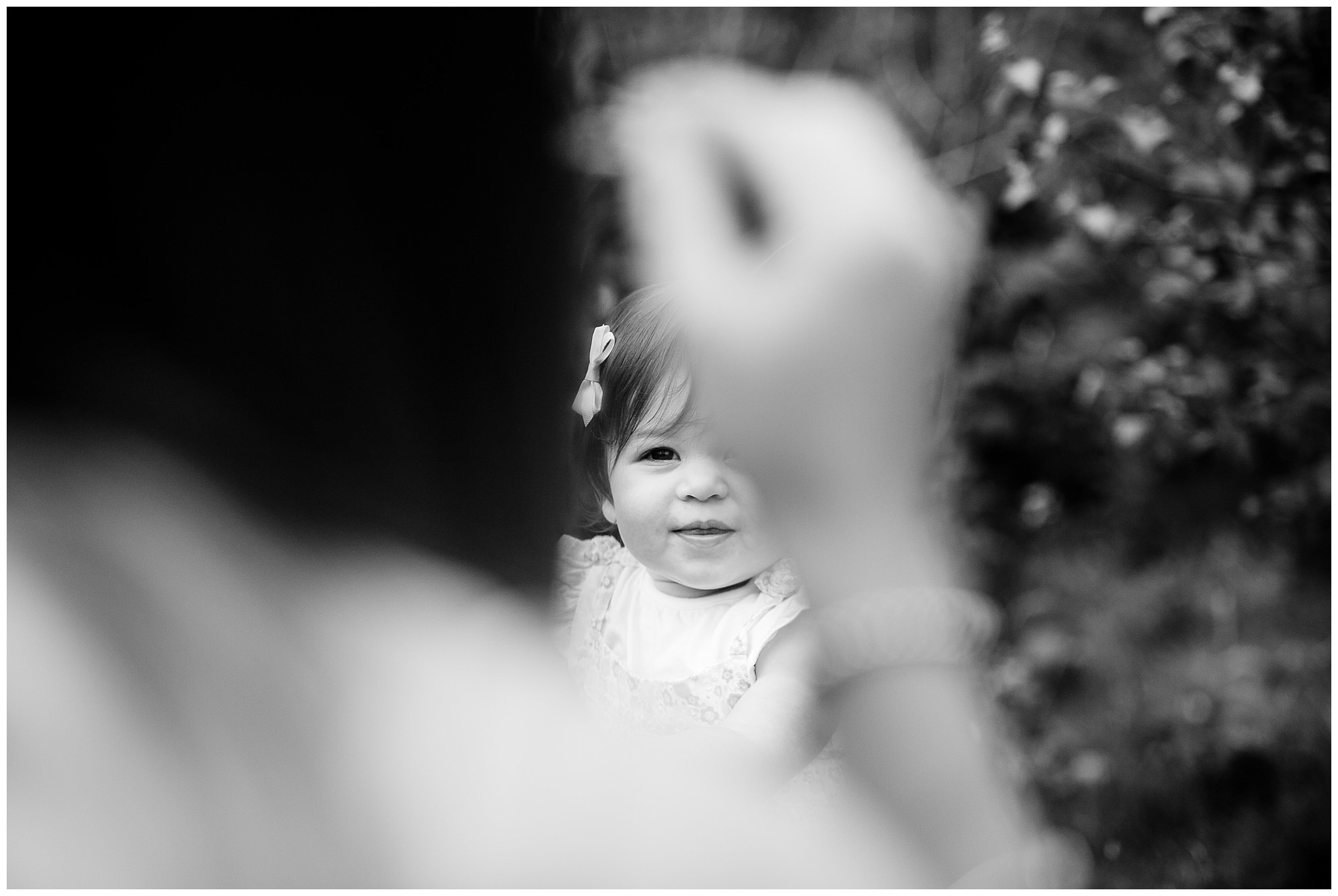 expression of baby girl looking at her mummy blowing bubbles - family photographer