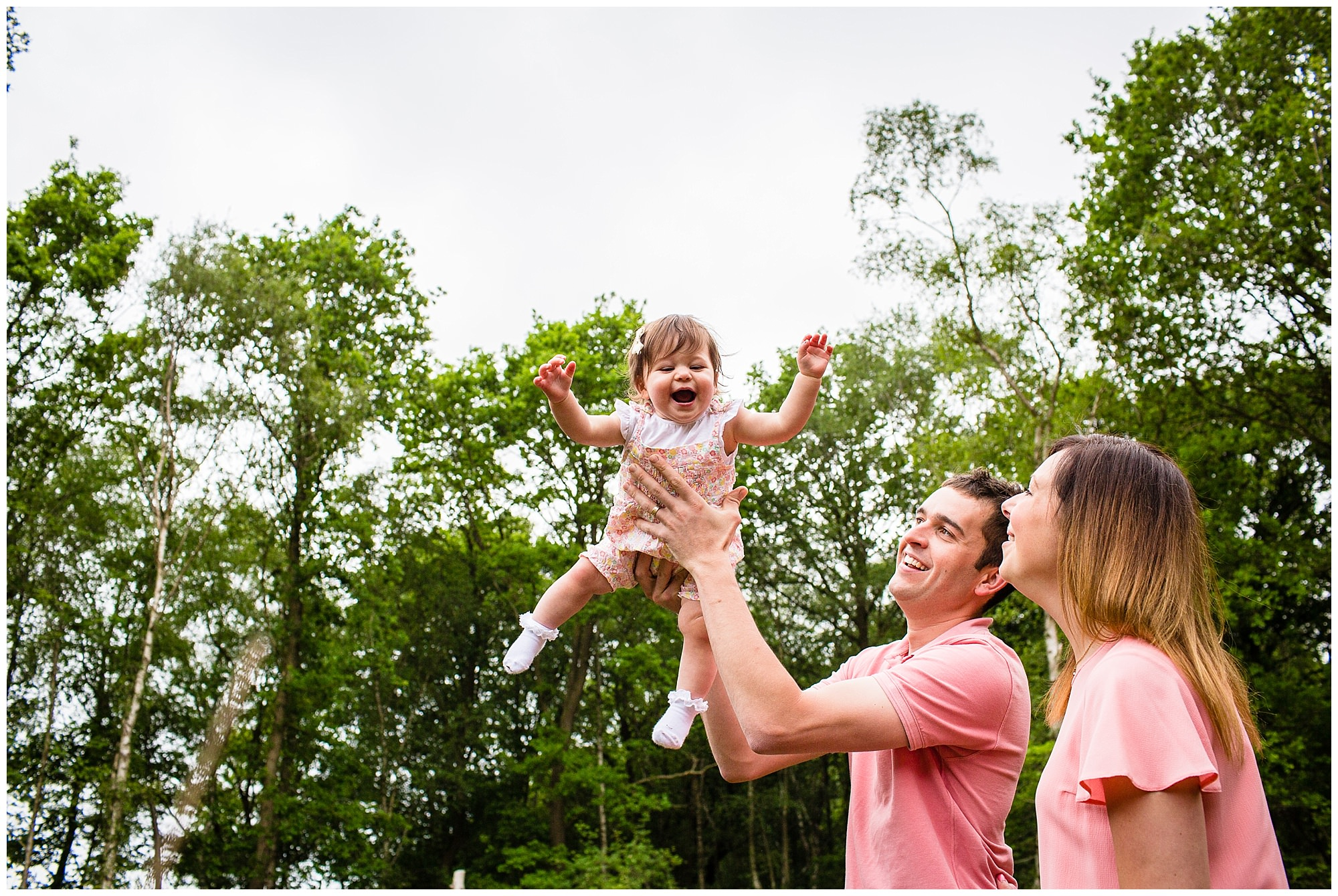 daddy throwing baby up into the air finding it hilarious - shropshire family photographer