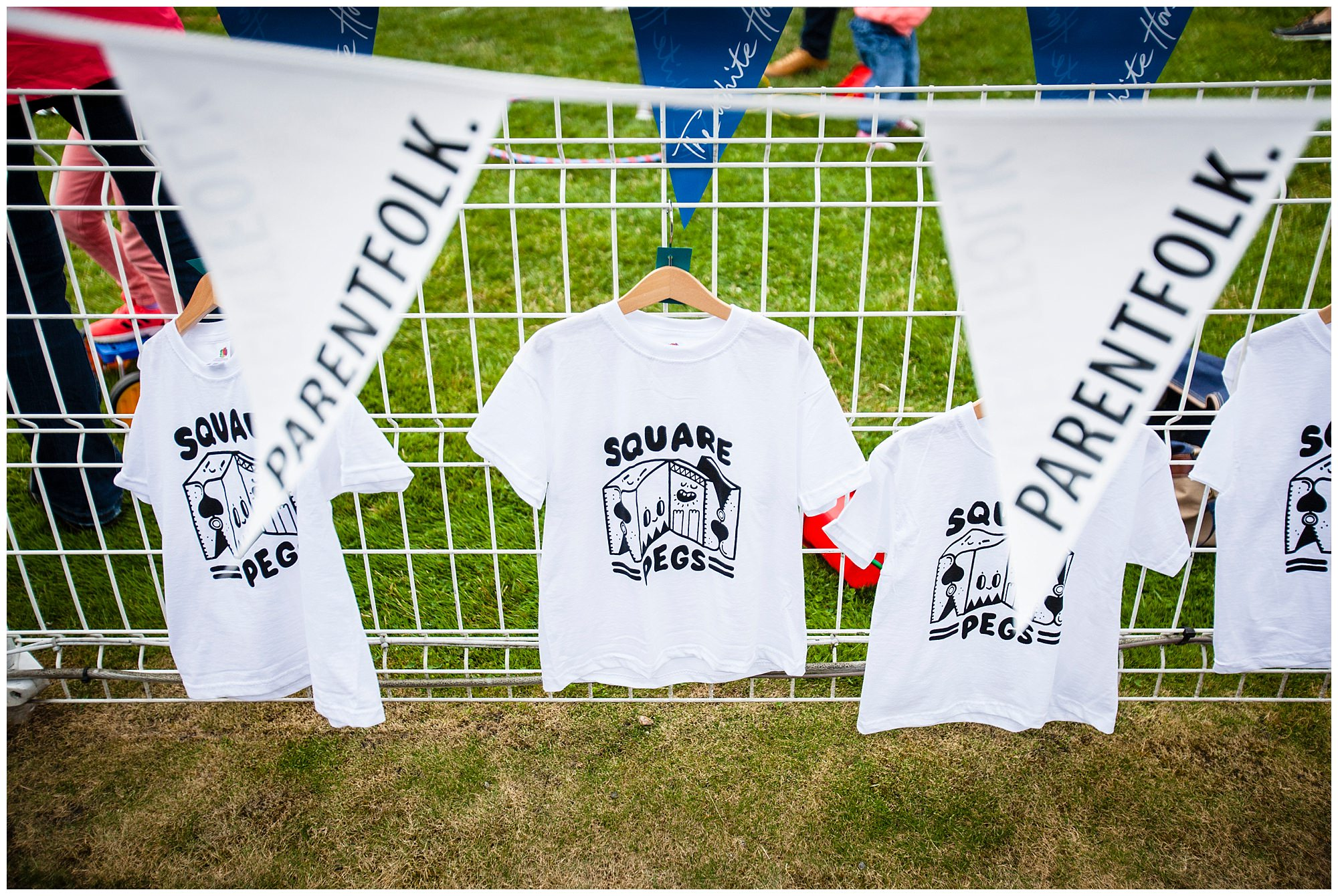 Screen Printed t-shirts drying on railings run by Square Pegs - Cheshire Family Event Photographer Charlotte Giddings
