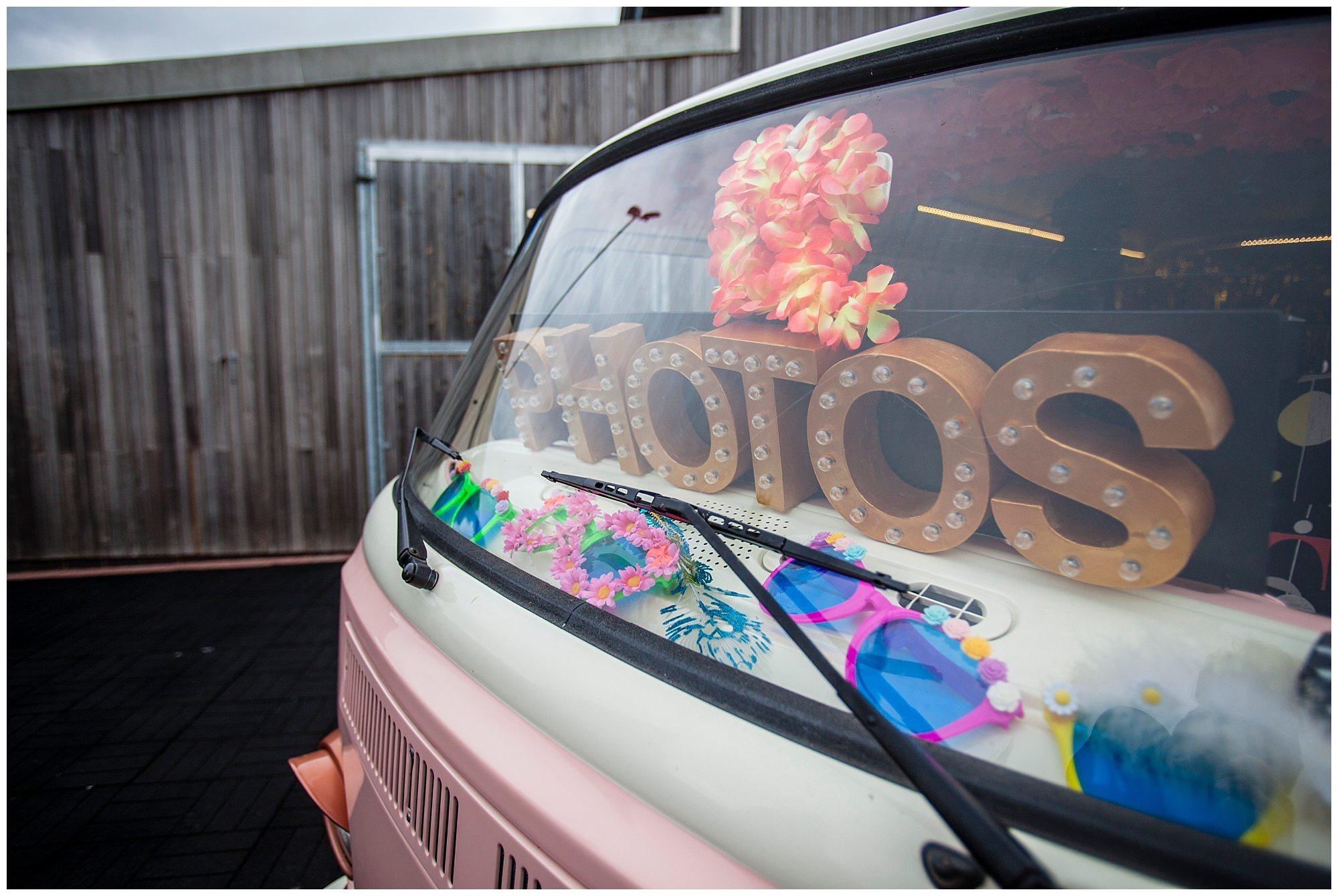 back of pink vw camper van vintage signage photos in the back