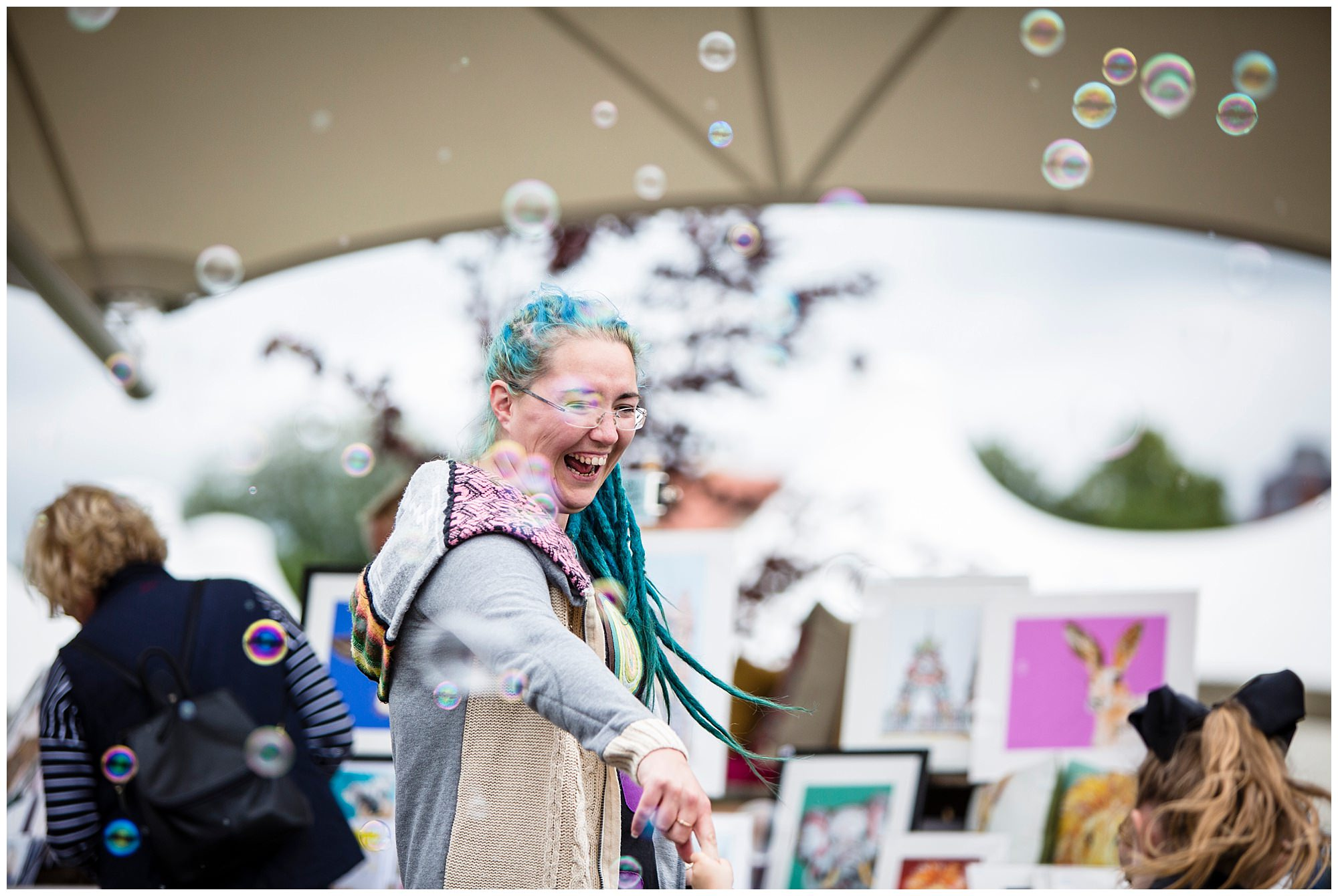 cool lady dancing amongst the bubbles at chester race course event parentfolk