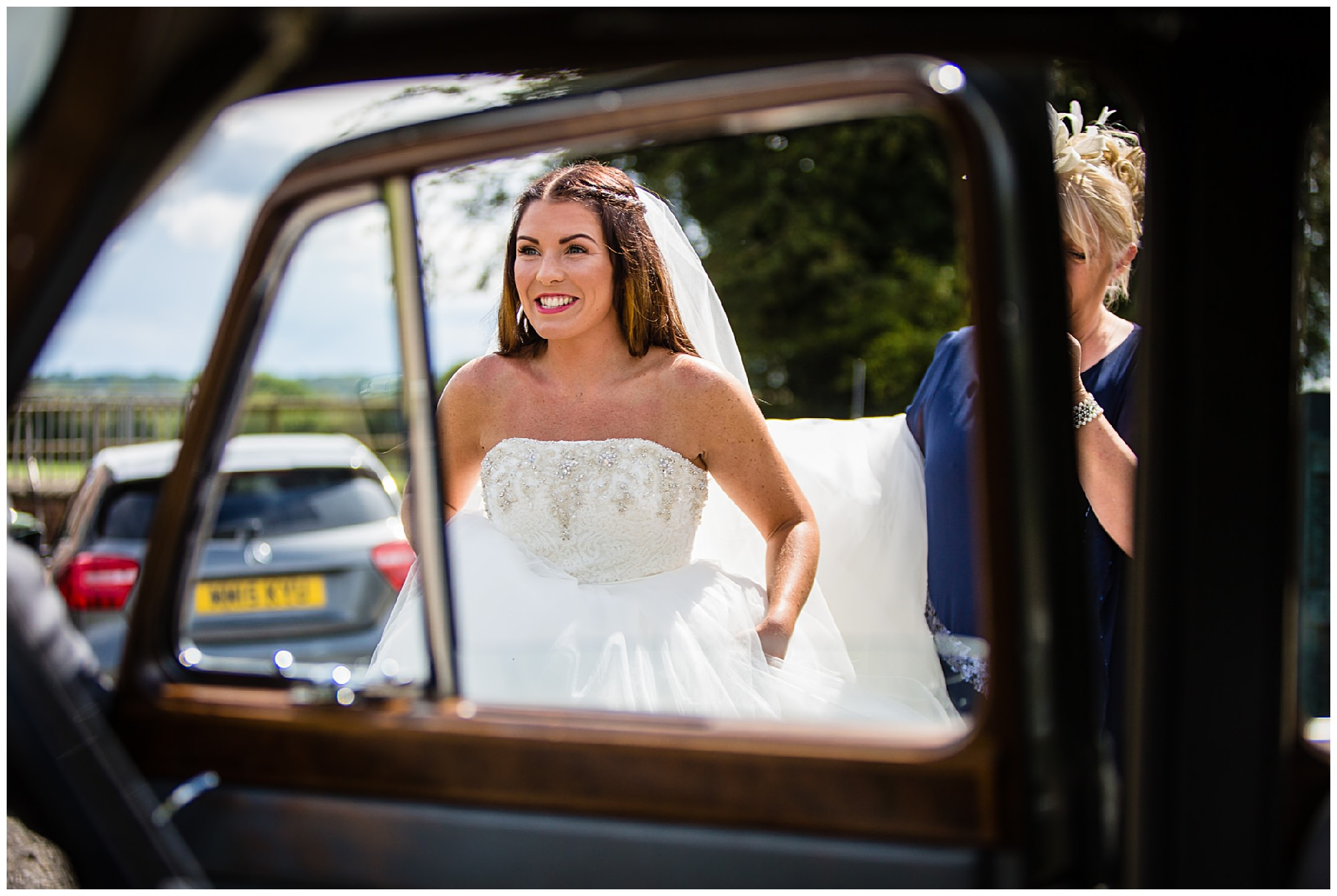 shot of bride getting into wedding car charlotte giddings photography