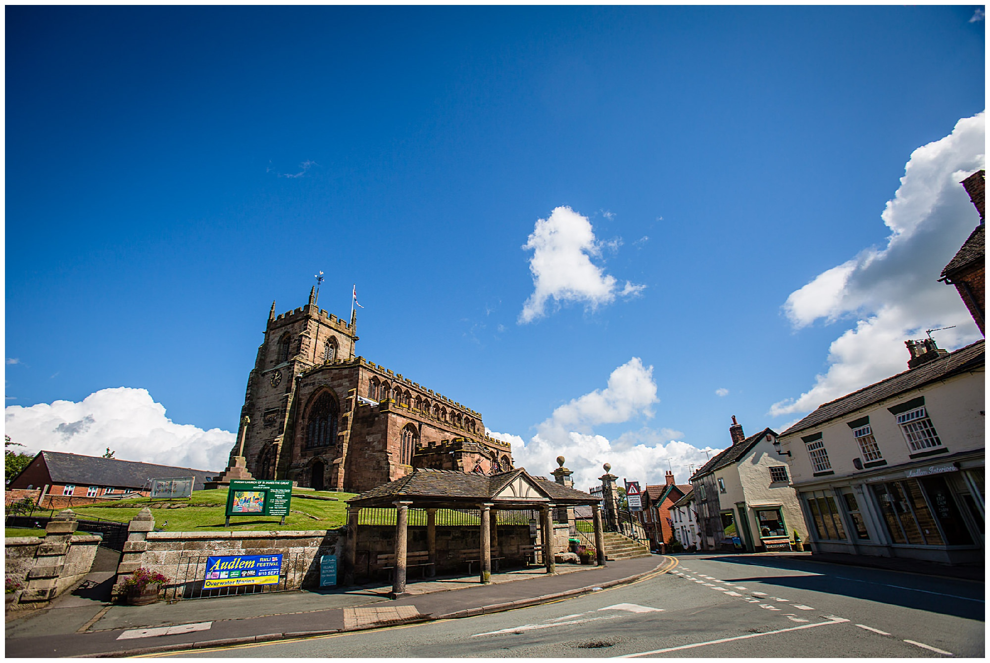 St. James' Church Audlem Wedding Photography- church with blue sky backdrop