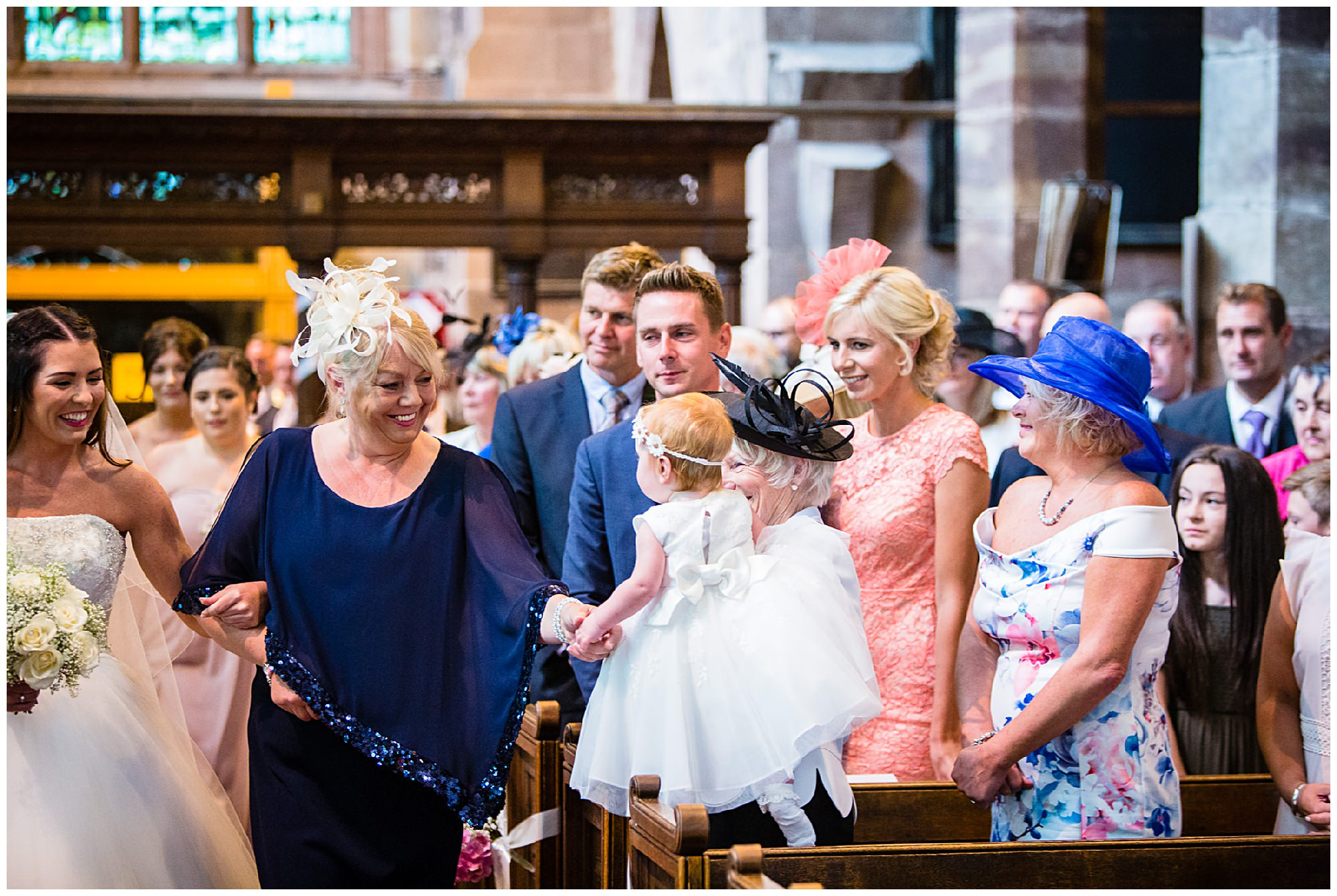 daughter looking at mummy the bride - St. James' Church Audlem Wedding Photography