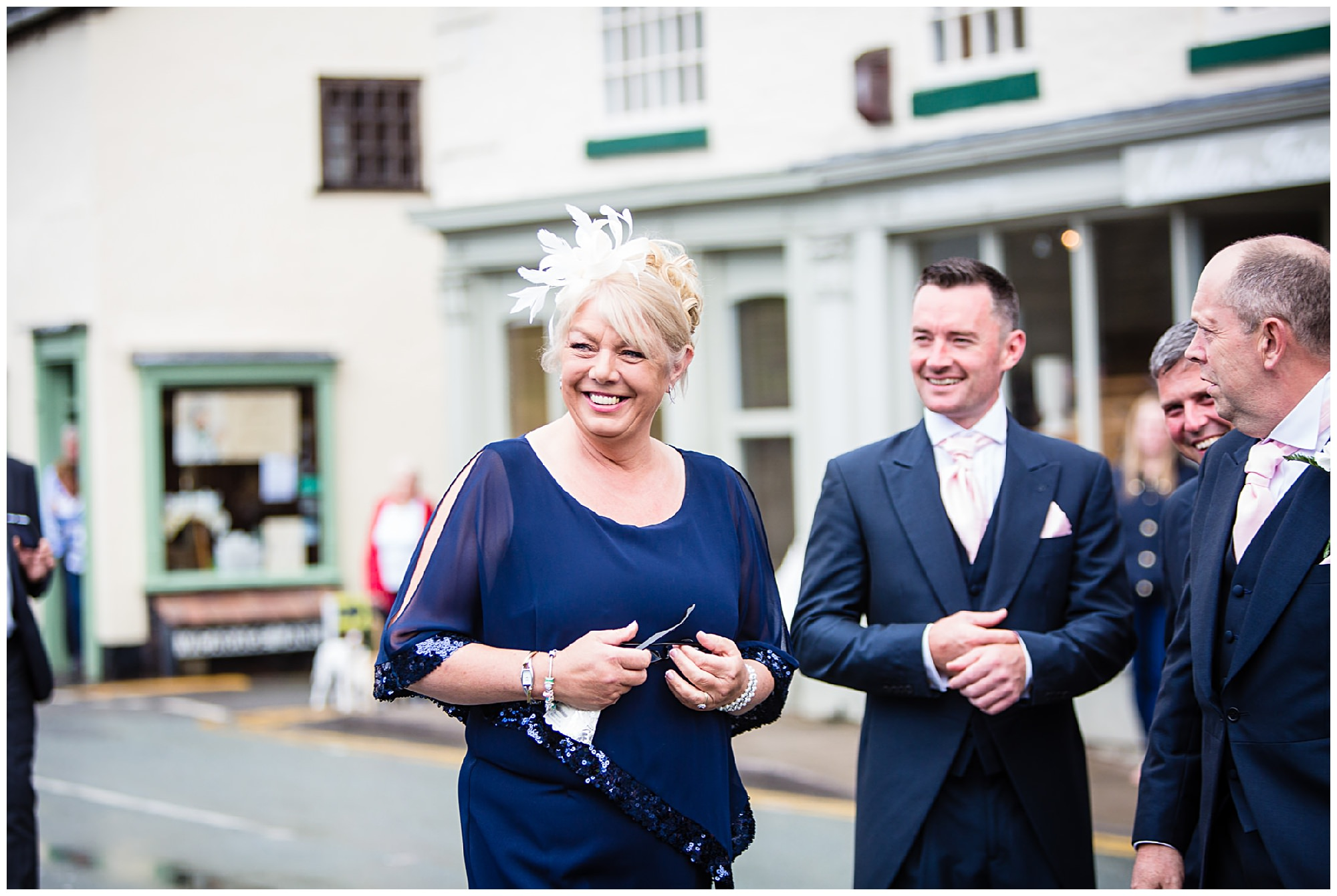 happy mother of the bride on looking - St James' Church Audlem Wedding Photography