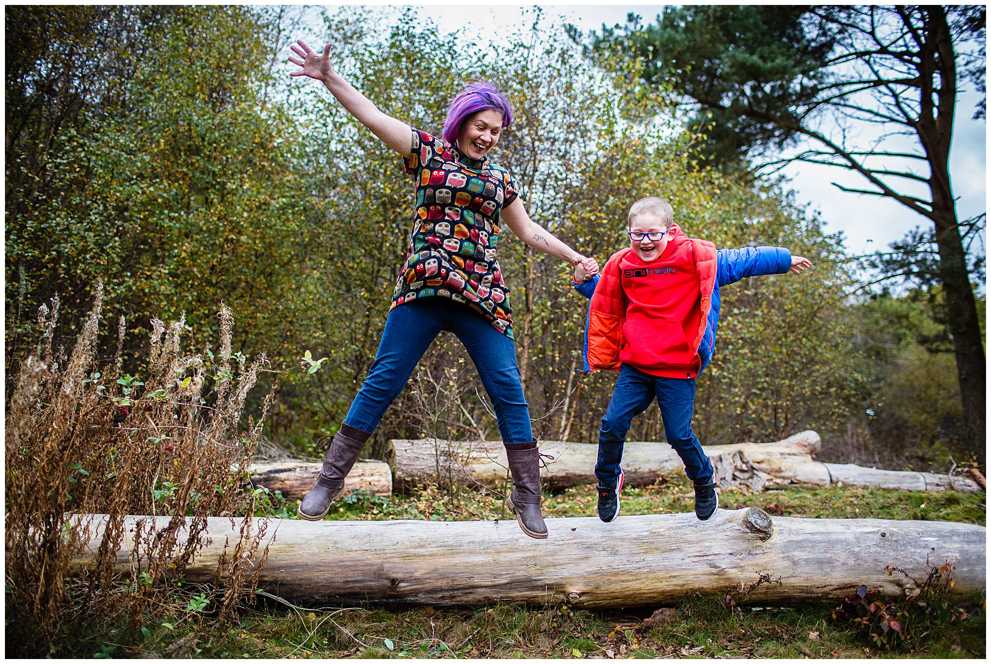 mum and son jumping off a log - Shropshire Mini Shoots