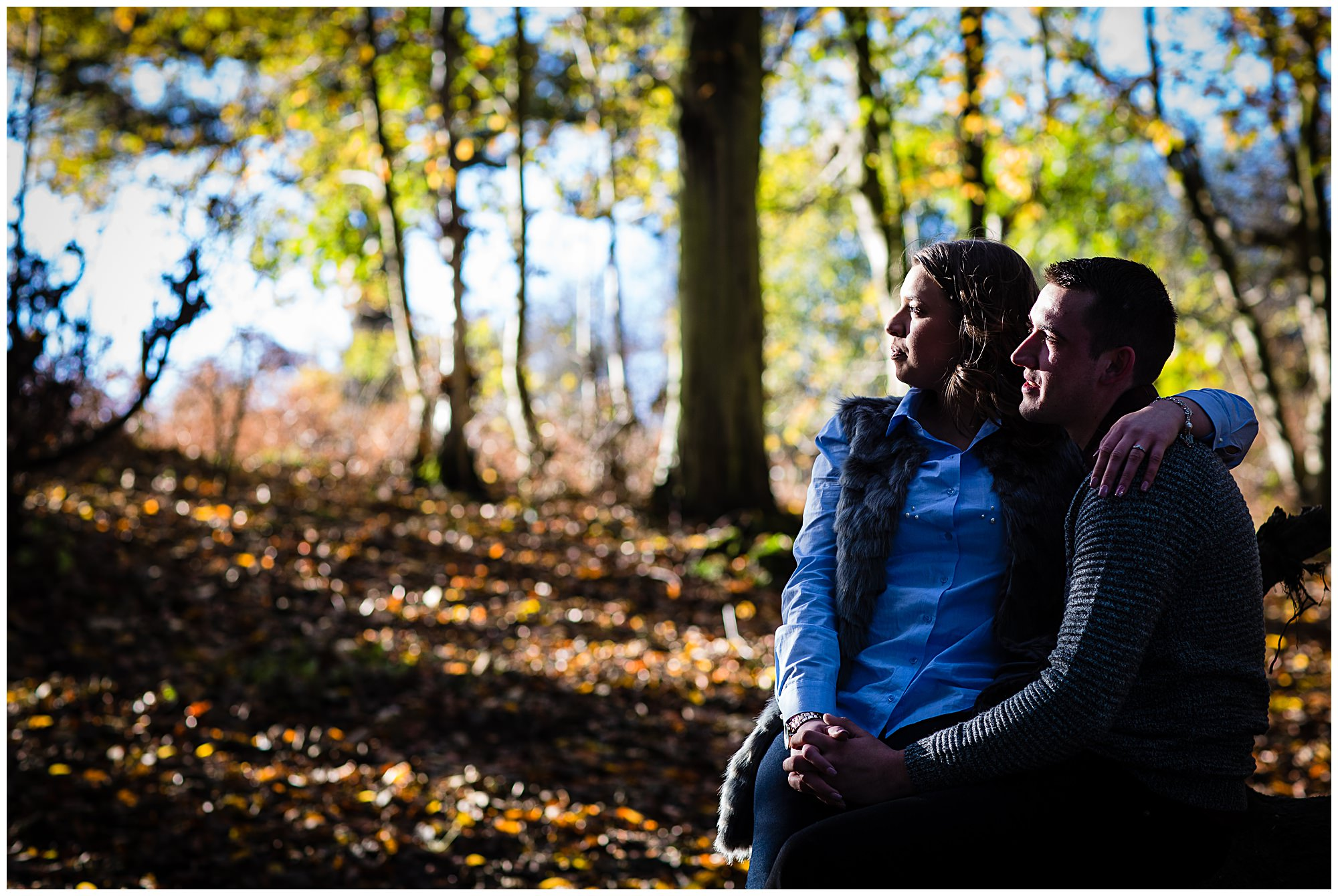 young couple having a moment in beautiful light looking into the distance