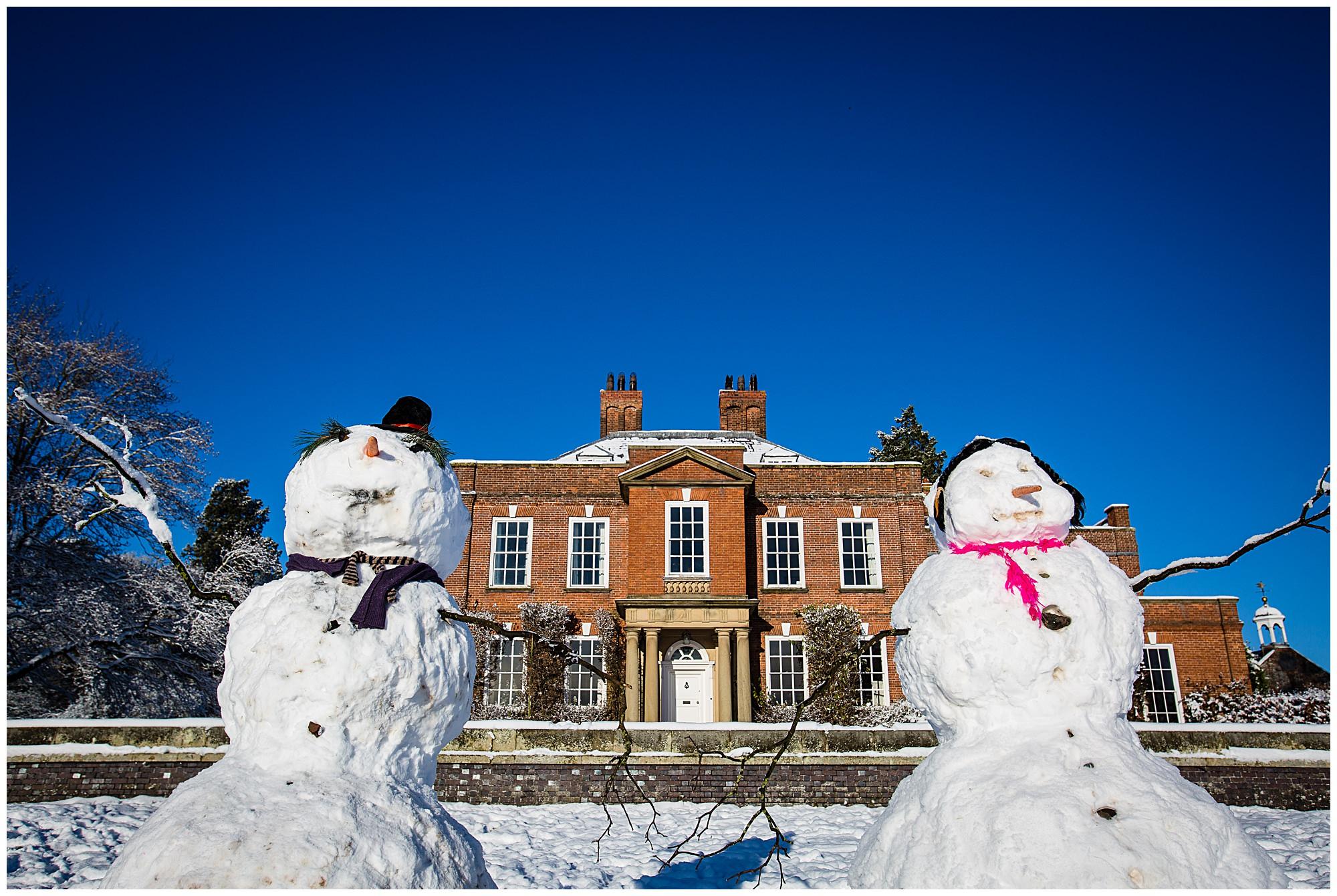 hand built snow men outside iscoyd park