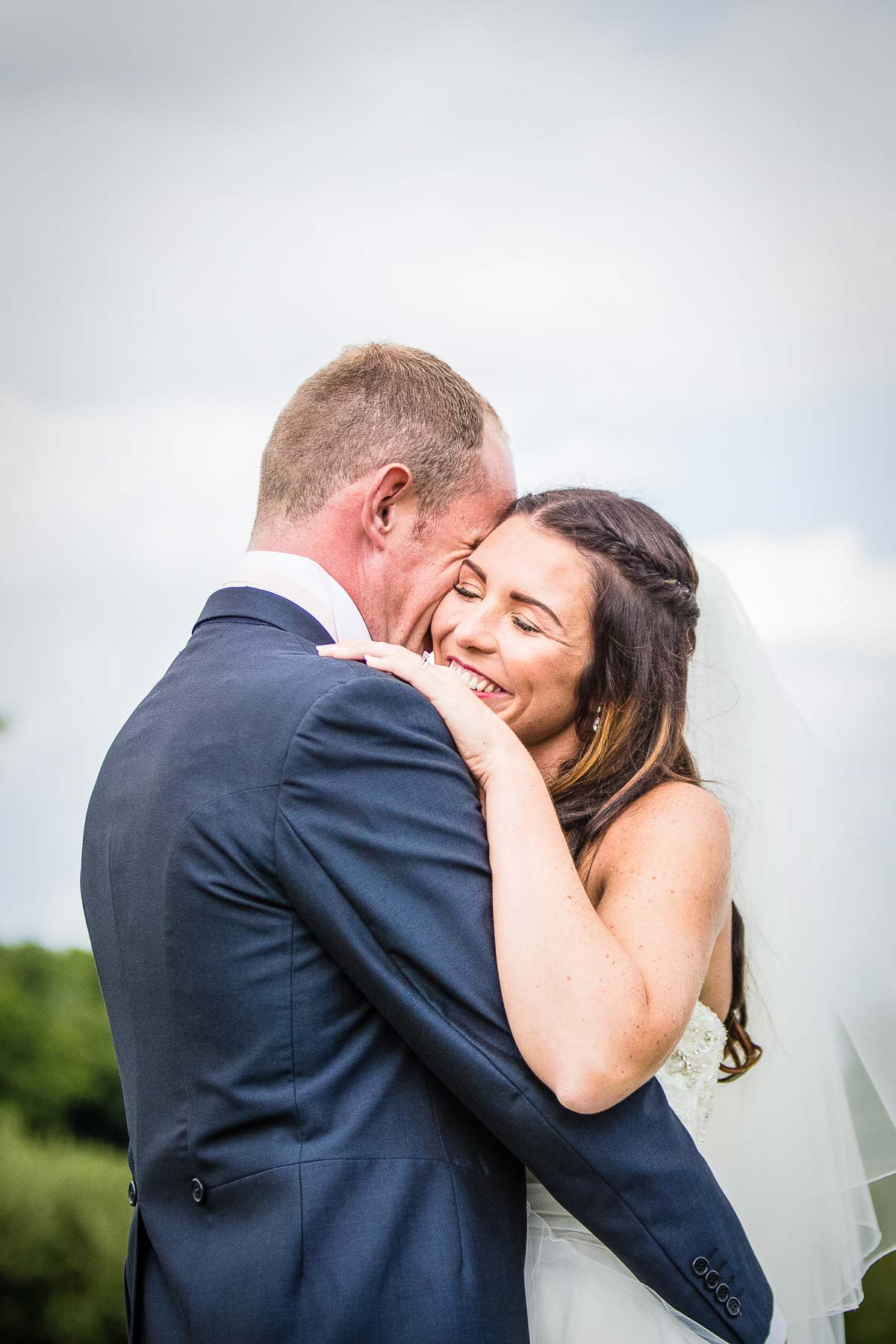 Couple cuddling at marquee wedding in Shropshire - Shropshire Wedding Photographer