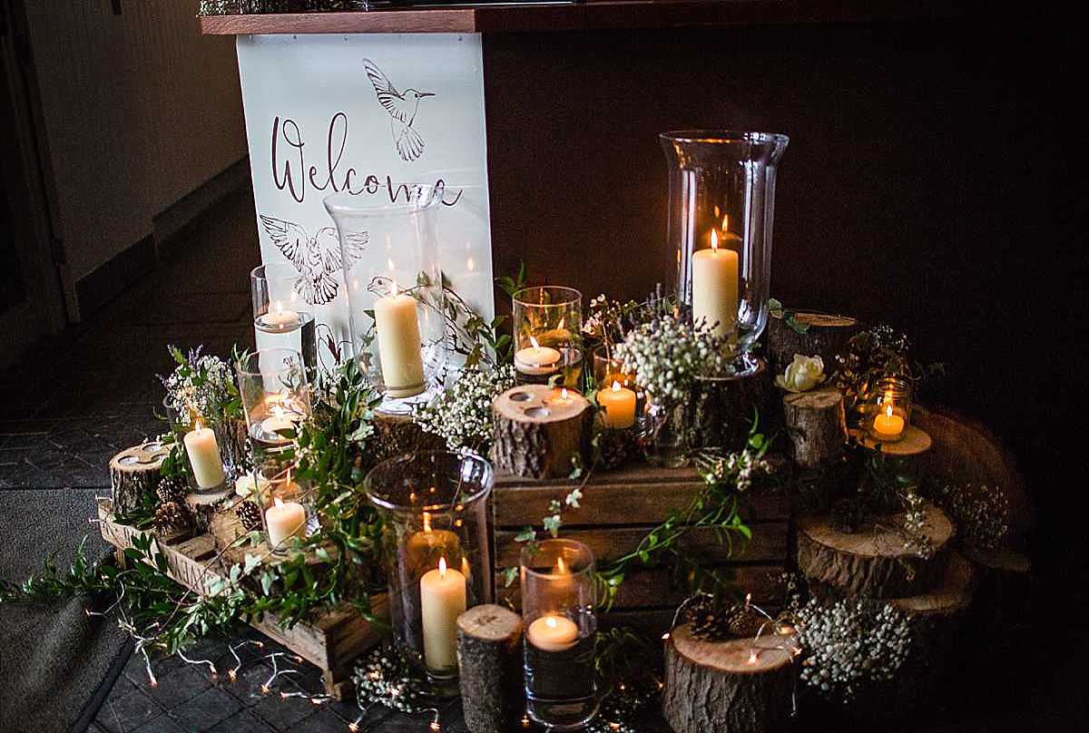 lots flowers and candle vintage style decor at cock o barton wedding by white wysteria in whitchurch