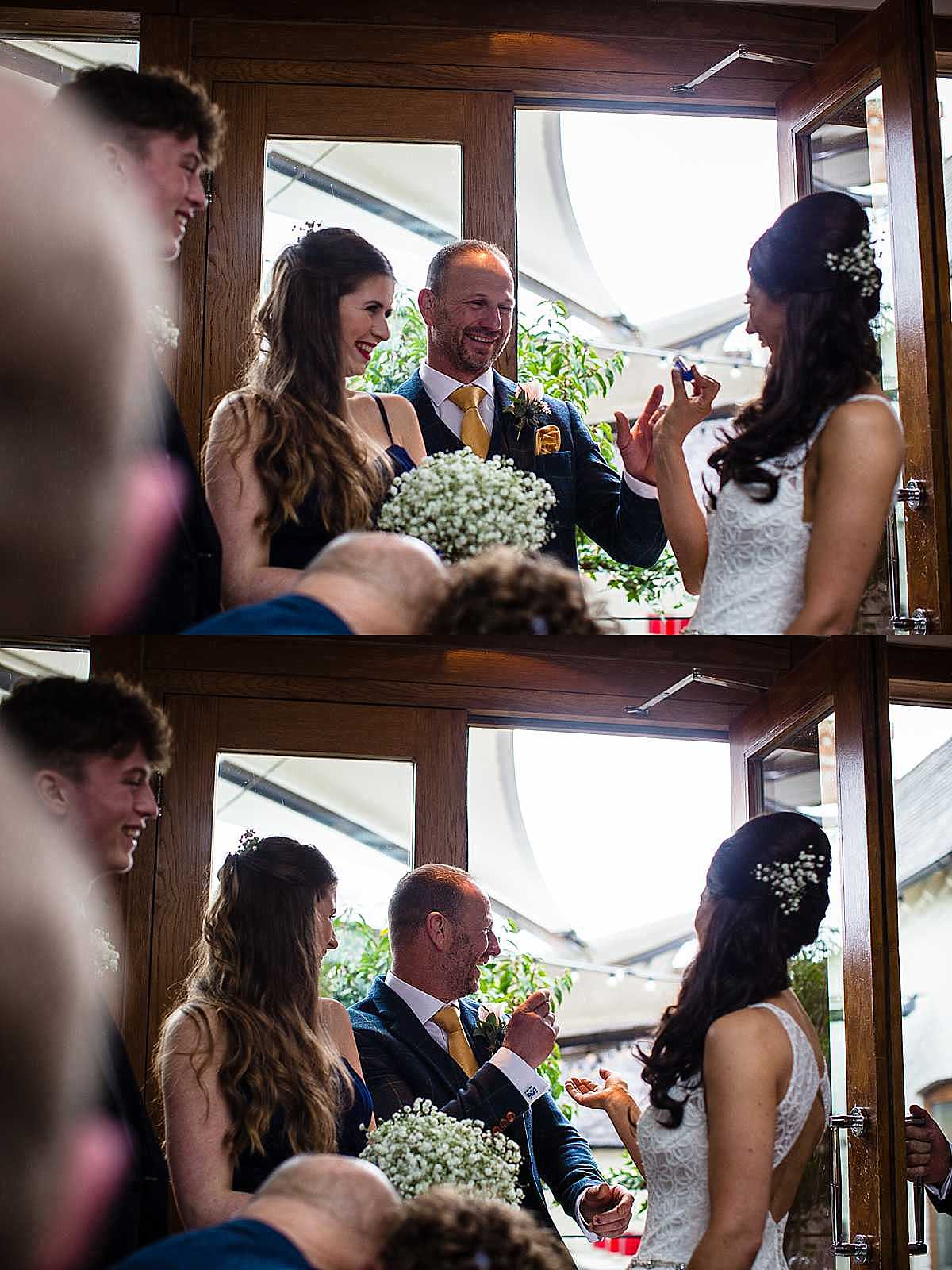 bride pulls lip balm out of her pocket of her wedding dress which makes the groom laugh and the groom goes to throw it as a joke