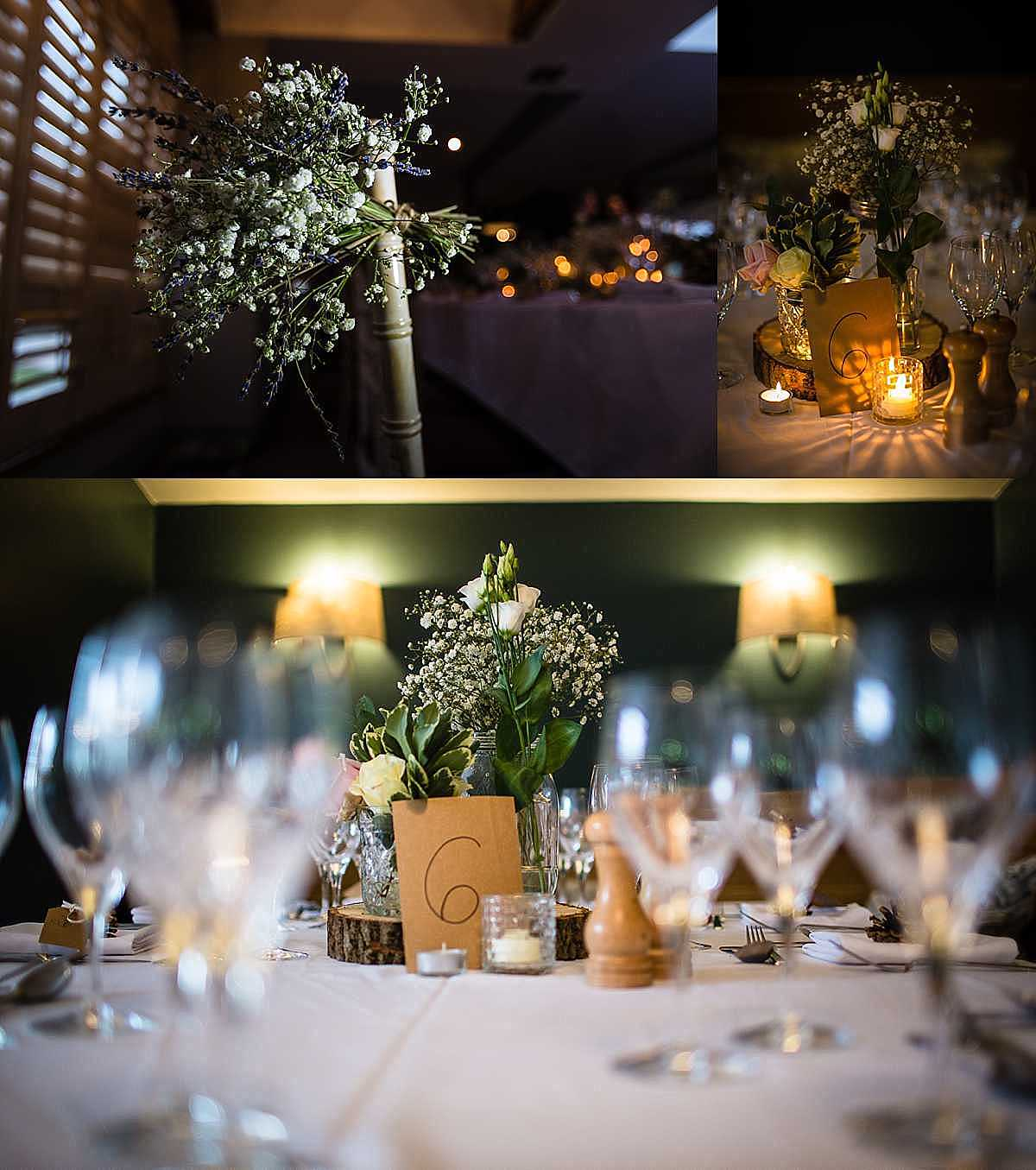 table details of delicate flowers in jam jars and wooden logs