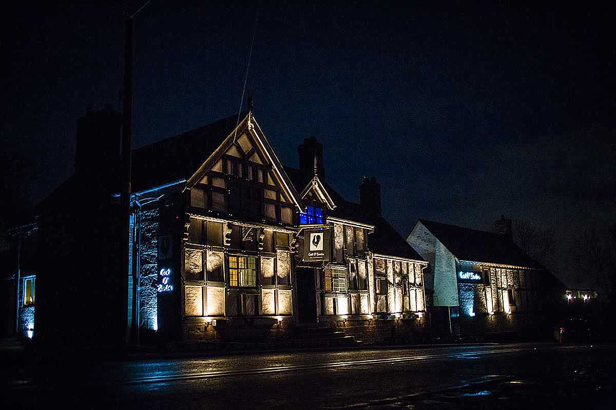 the cock o barton night time shot - all lit up on a winter wedding evening