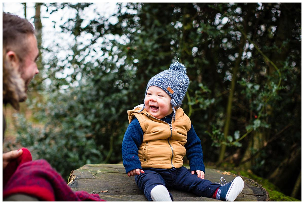 gorgeous smile from baby boy looking pleased as punch at this dad