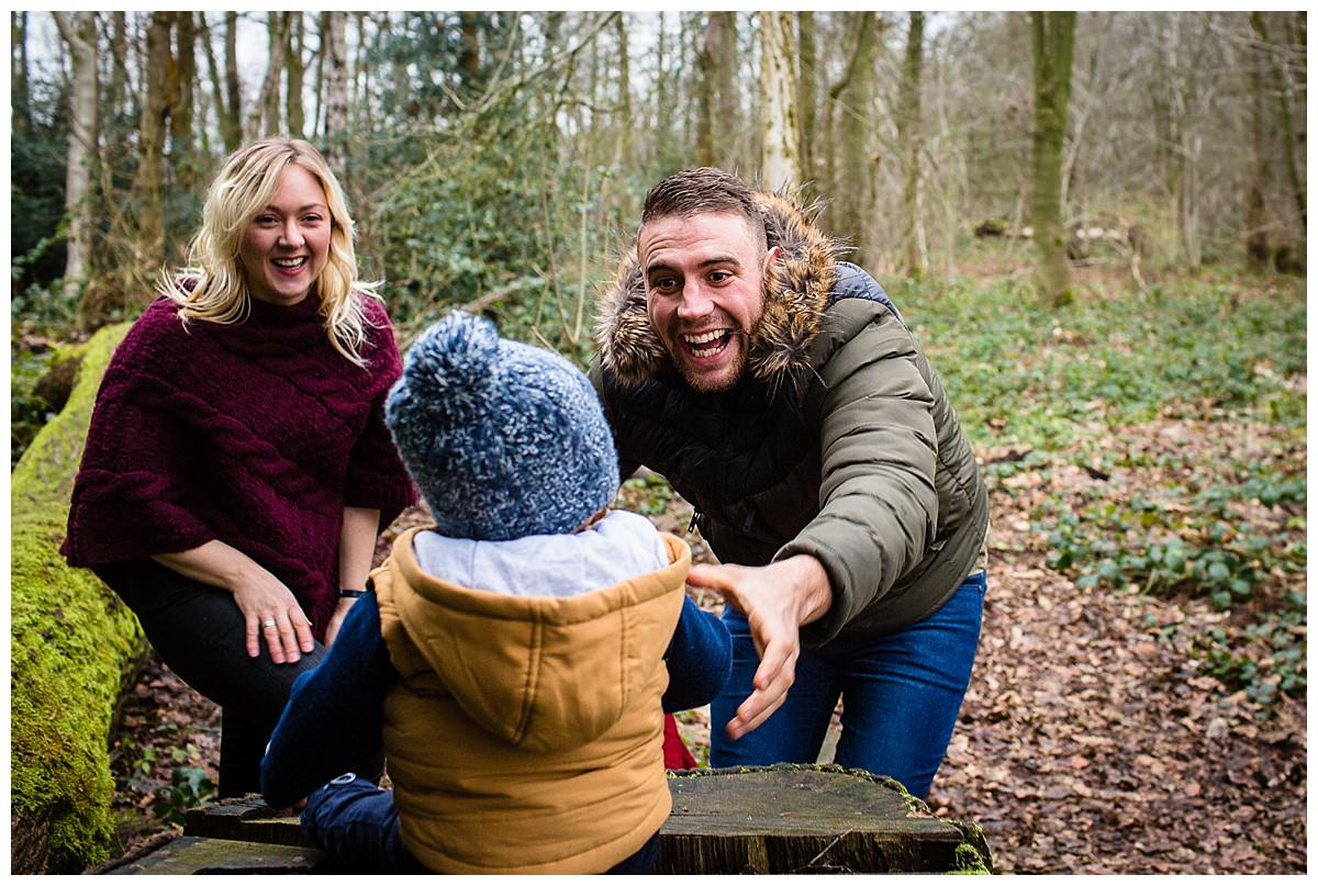 dad reaching out to get his son smiling - shropshire family photographer