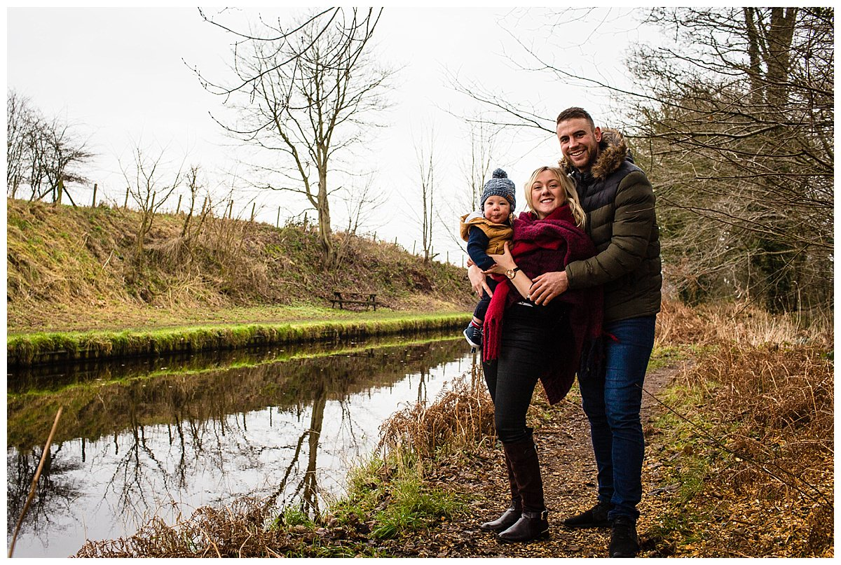 classic family photo everyone looking at the camera with shropshire union canal in the background