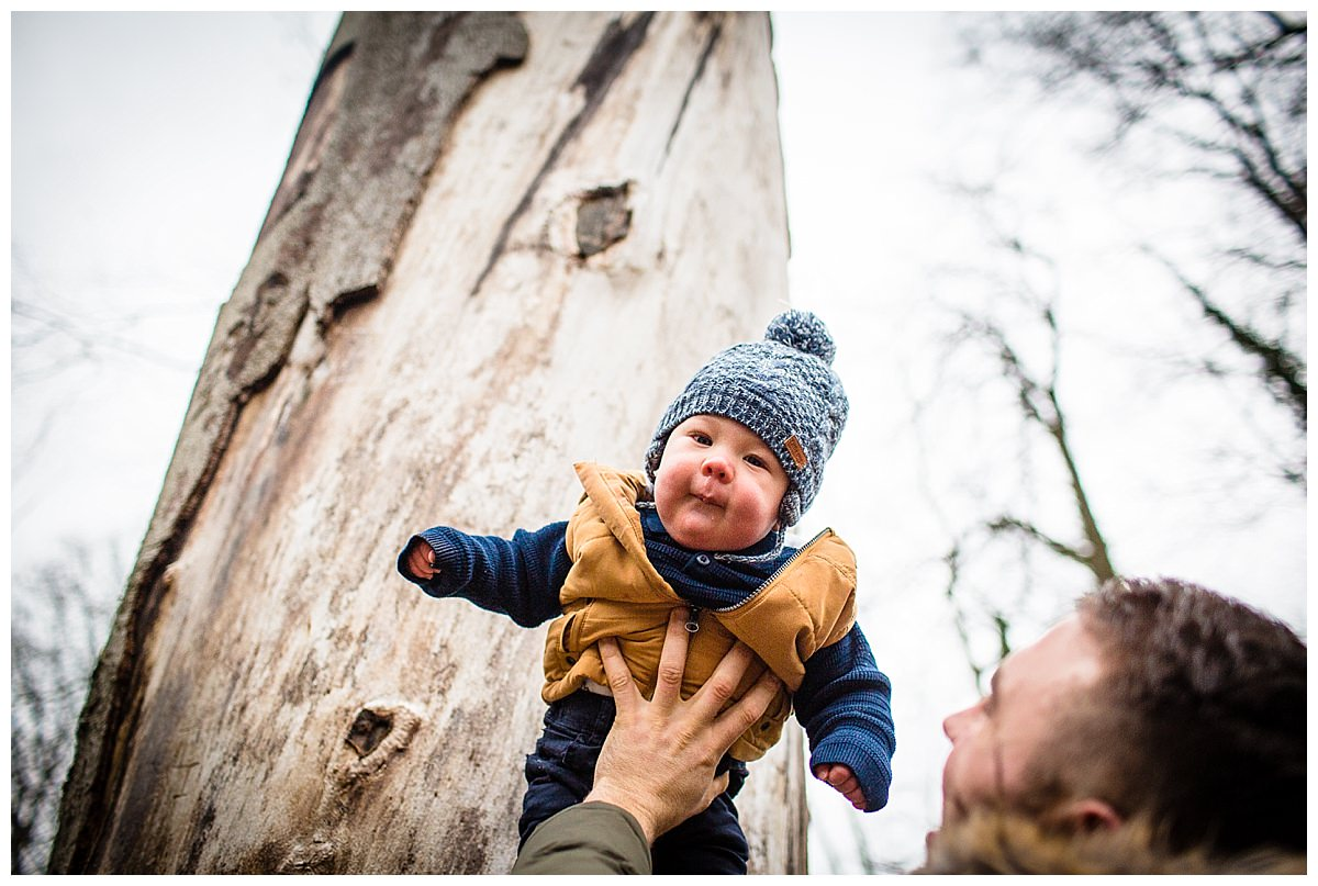 baby looking at camera in the air - family photographer shropshire