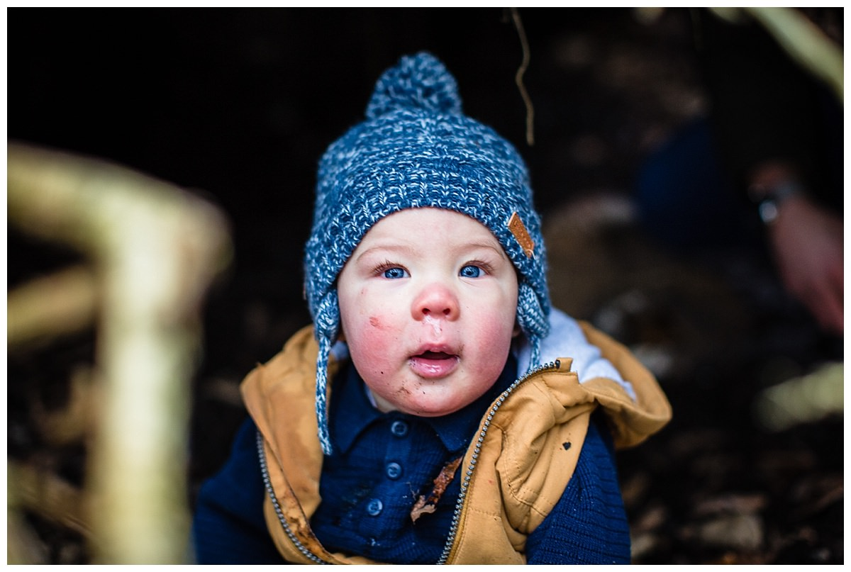 Gorgeous blue eyed baby with beautiful eye lashes looking at the camera family photography shropshire