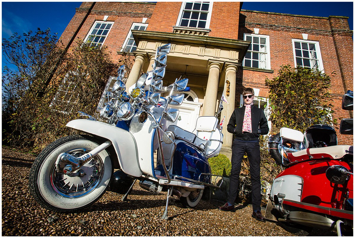 lambretta scooters and mod model outside iscoyd park for styled shoot in the winter