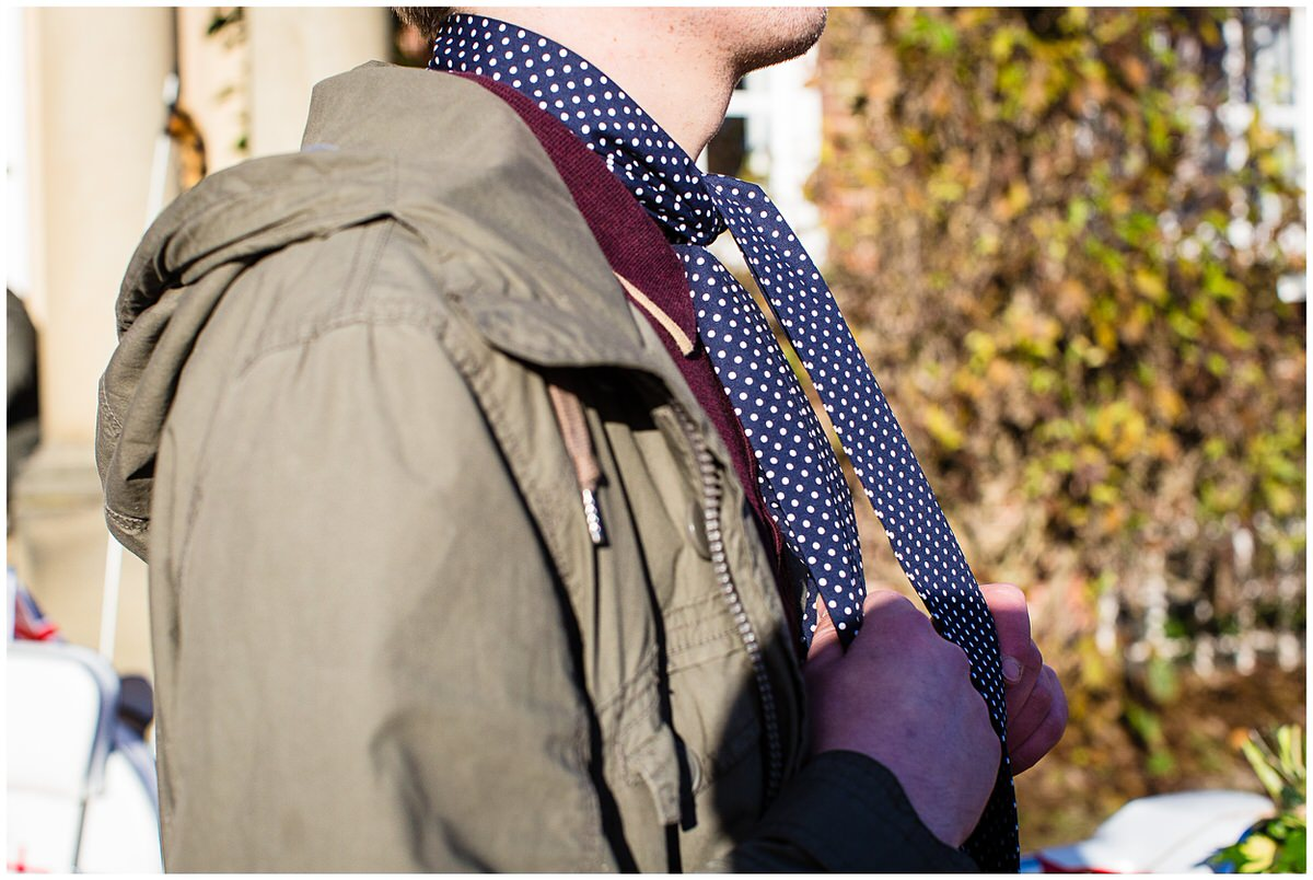 detaill shot of model holding scarf with two hands during styled shoot at iscoyd park