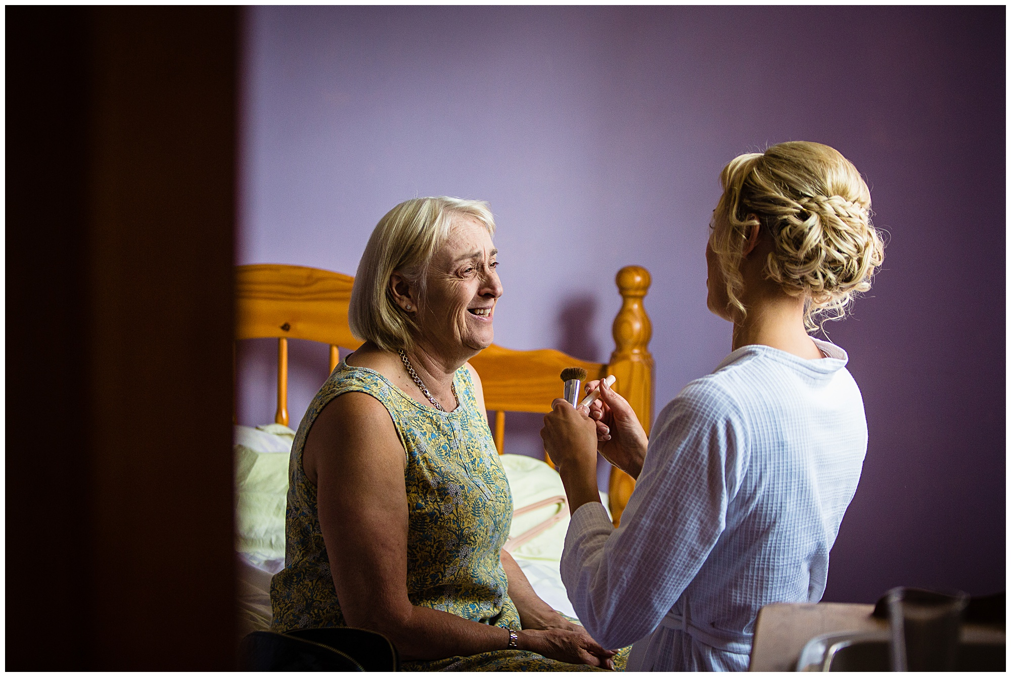 bride doing her mums makeup in the morning of wedding day