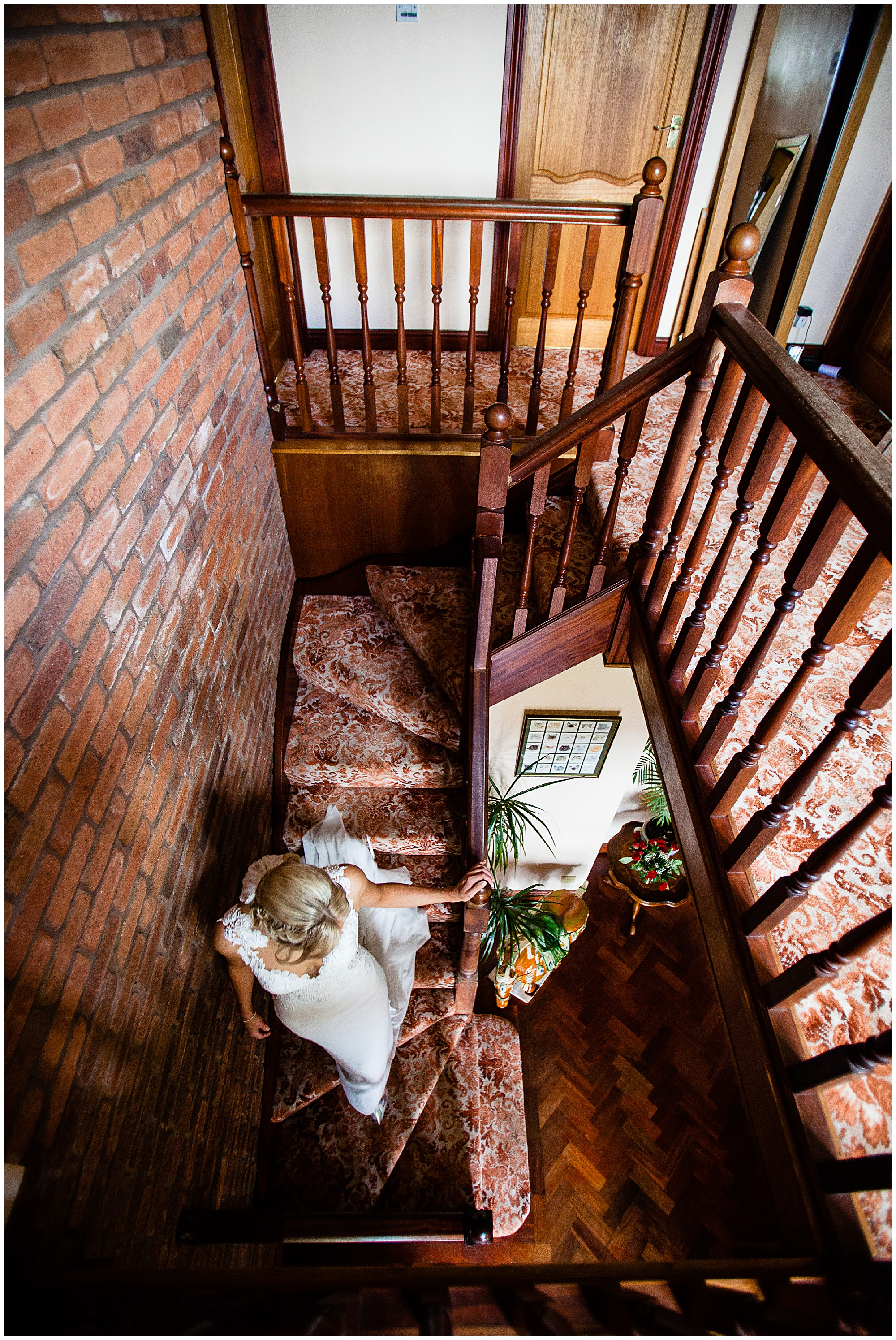 going down the stairs at home girls at the botom of the stairs