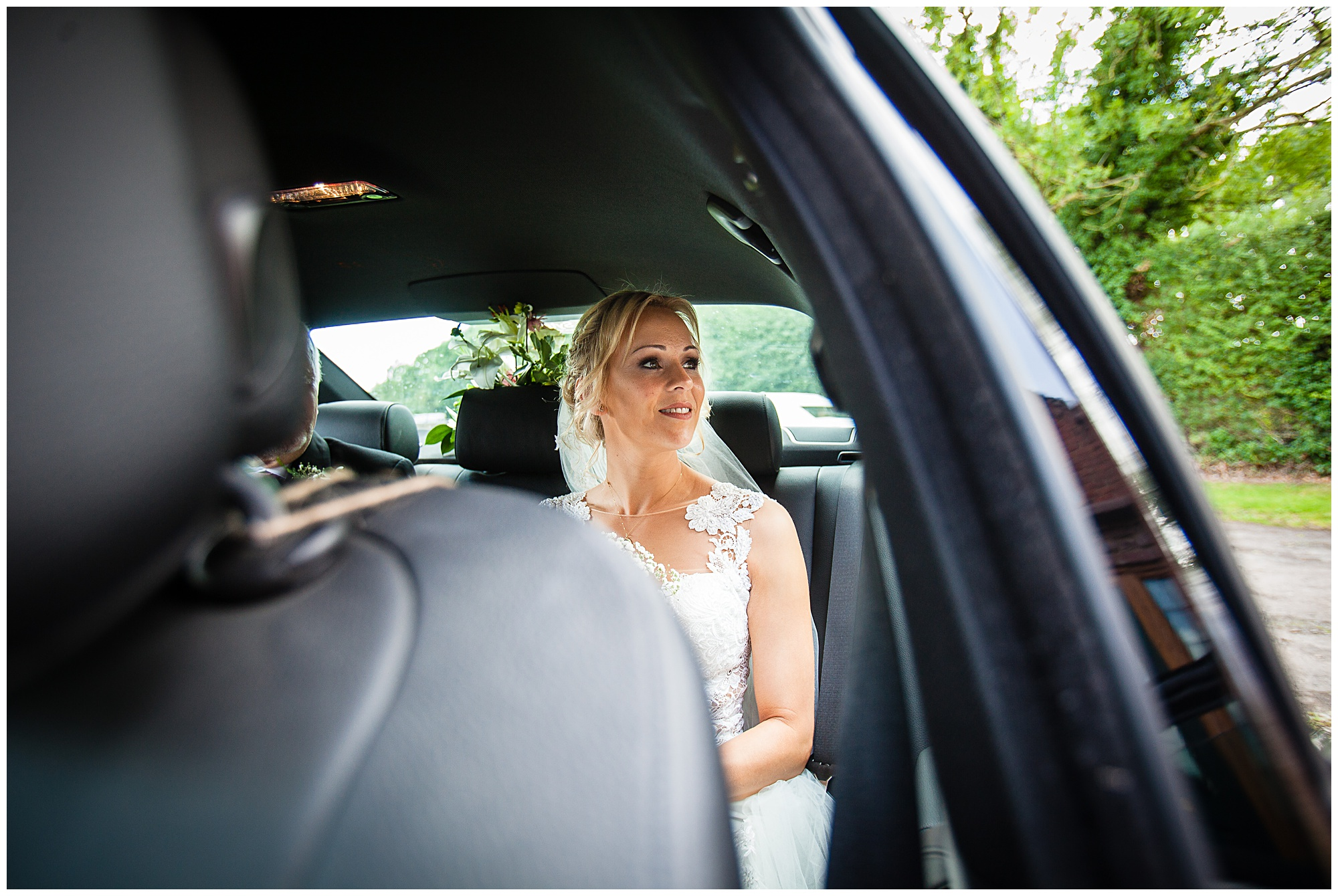 bride looking out of the window before she leaves for church