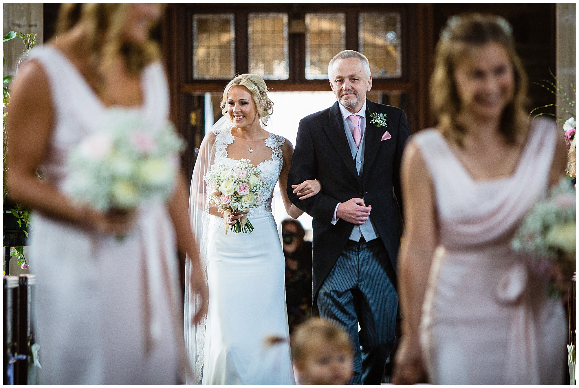 a very excited brdge and dad walking down the aisle - shrophire wedding photographer