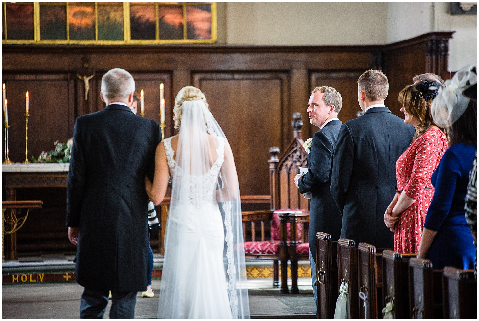 grooms very impressed shot of the bride - first look down the aisle - shropshire wedding photographer